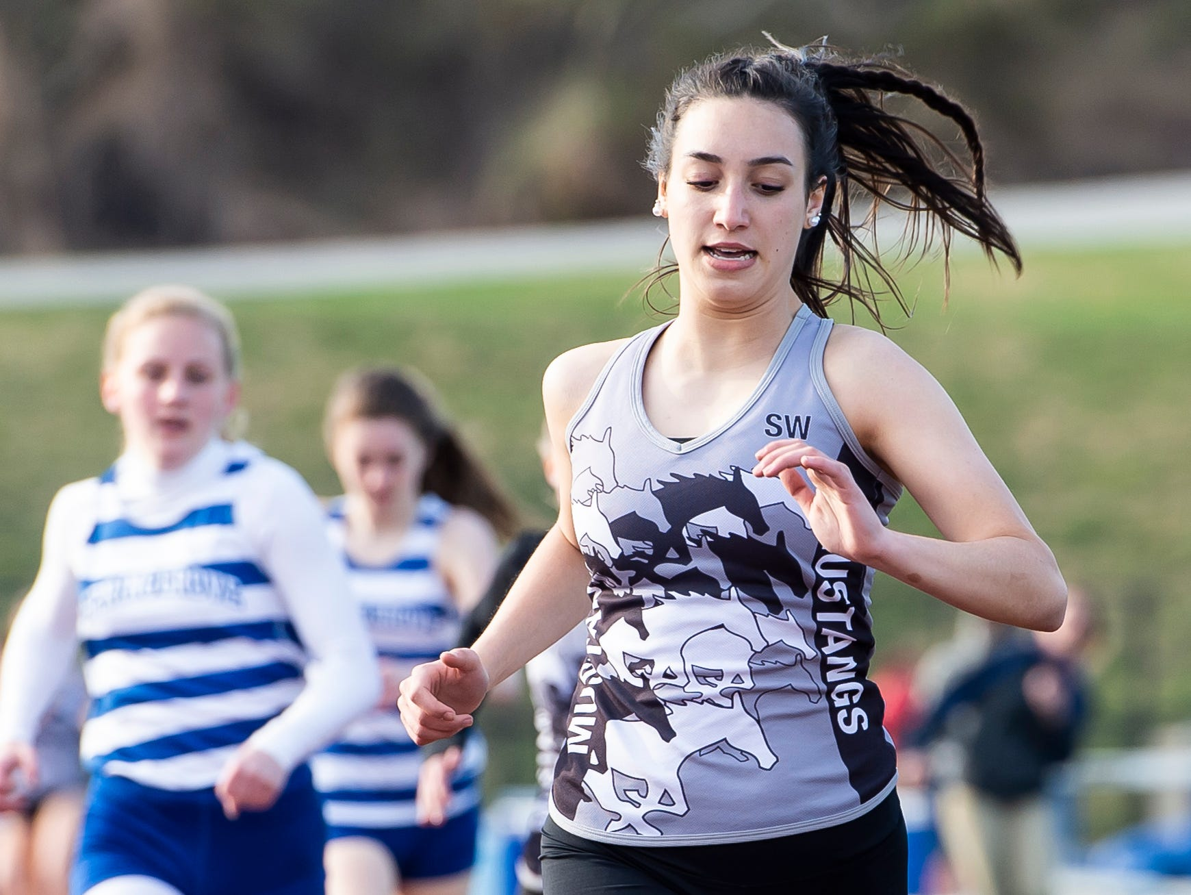South Western' Bella Gilberto takes first in the girls' 800m during a track and field meet against Spring Grove on Thursday, April 11, 2019.