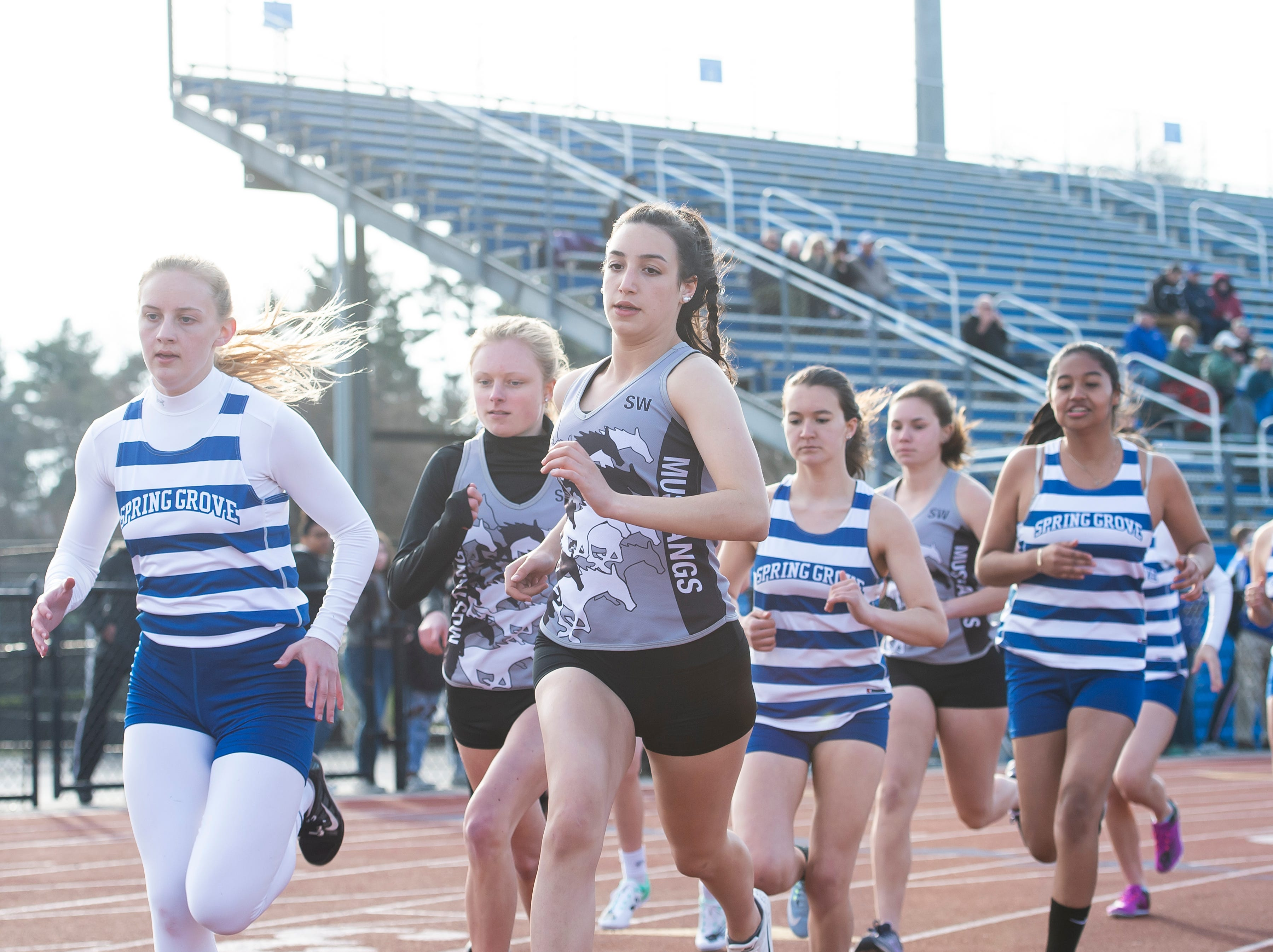 Spring Grove and South Western competitors take off in the 800m run on Thursday, April 11, 2019.