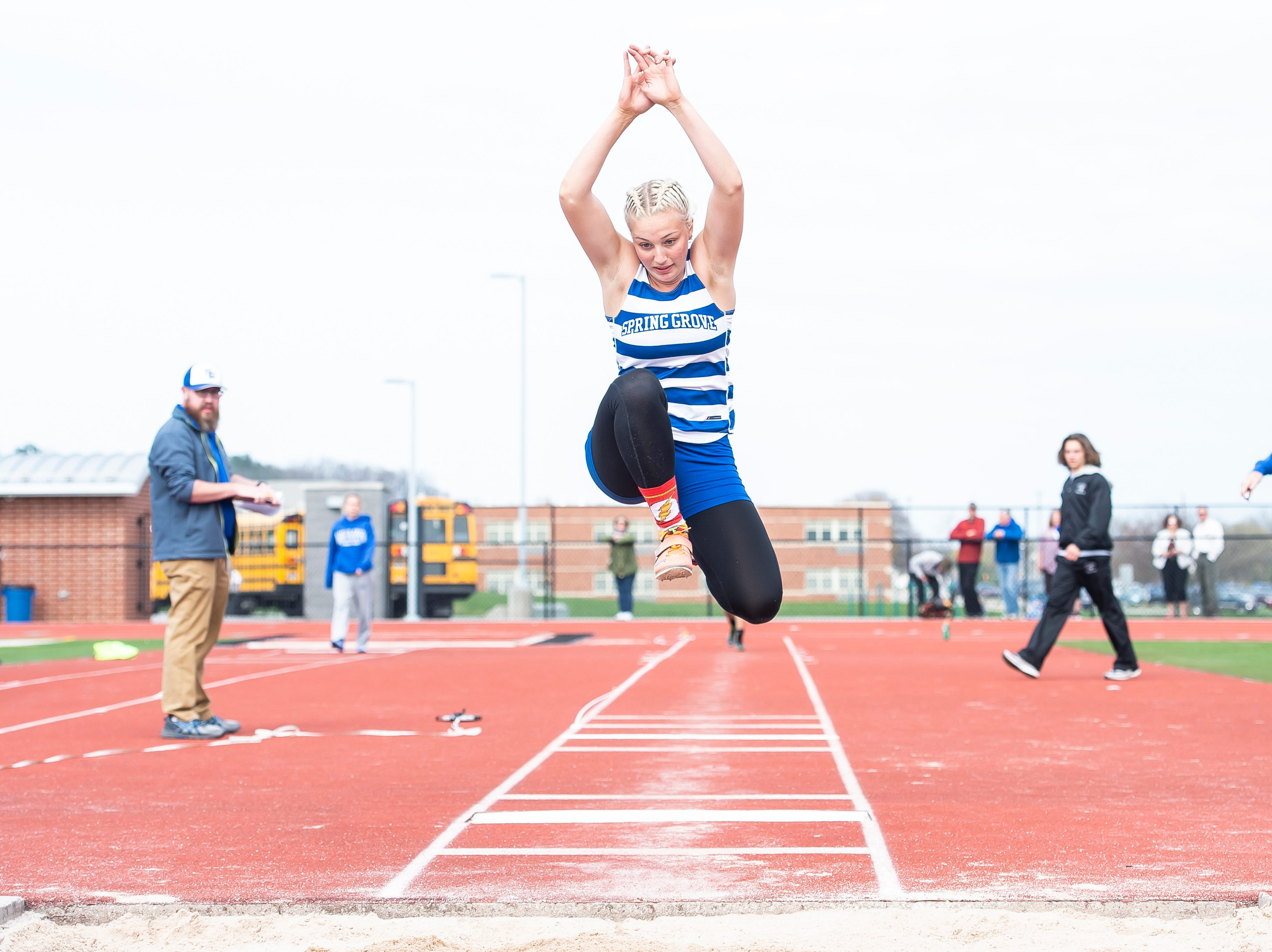 Spring Grove's Angel Rohrbaugh competes in the triple jump during a track and field meet against South Western on Thursday, April 11, 2019.