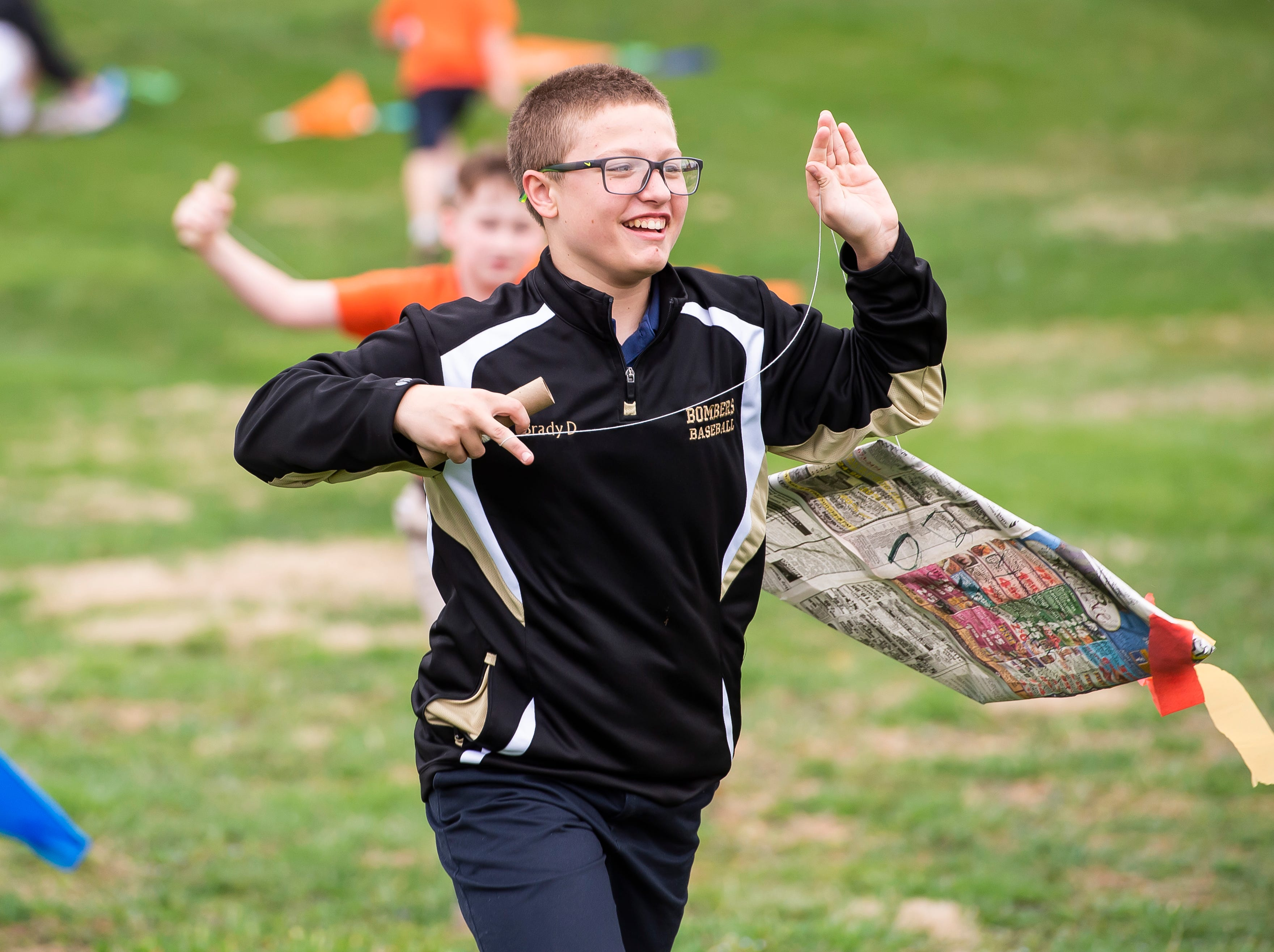Students from St. Teresa of Calcutta Catholic School fly their homemade kites at the school's Conewago campus on Friday, April 12, 2019.