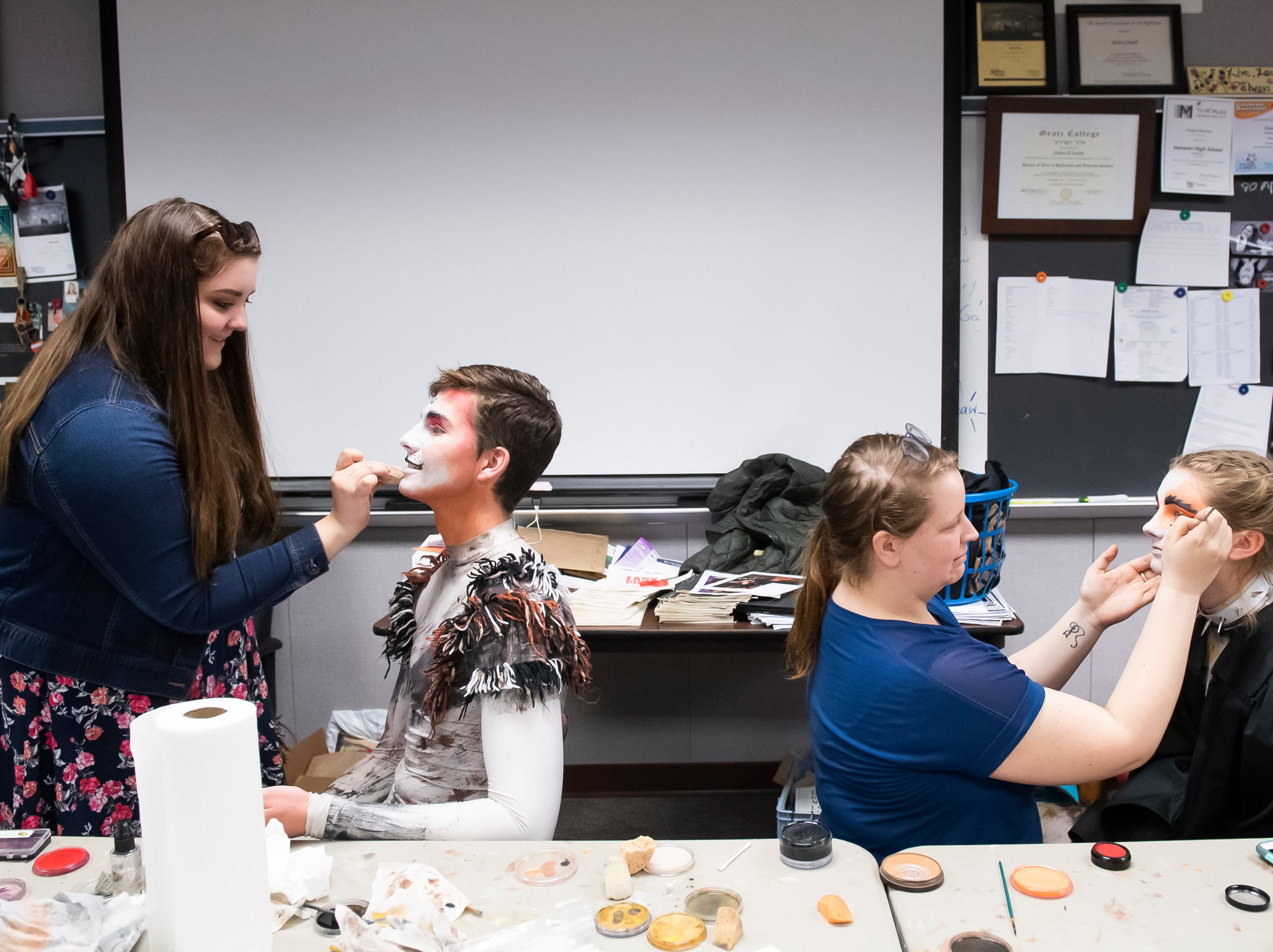 """Hanover High School students get their makeup done before the start of a dress rehearsal for their production of the musical """"Cats"""" on Wednesday, April 10, 2019."""
