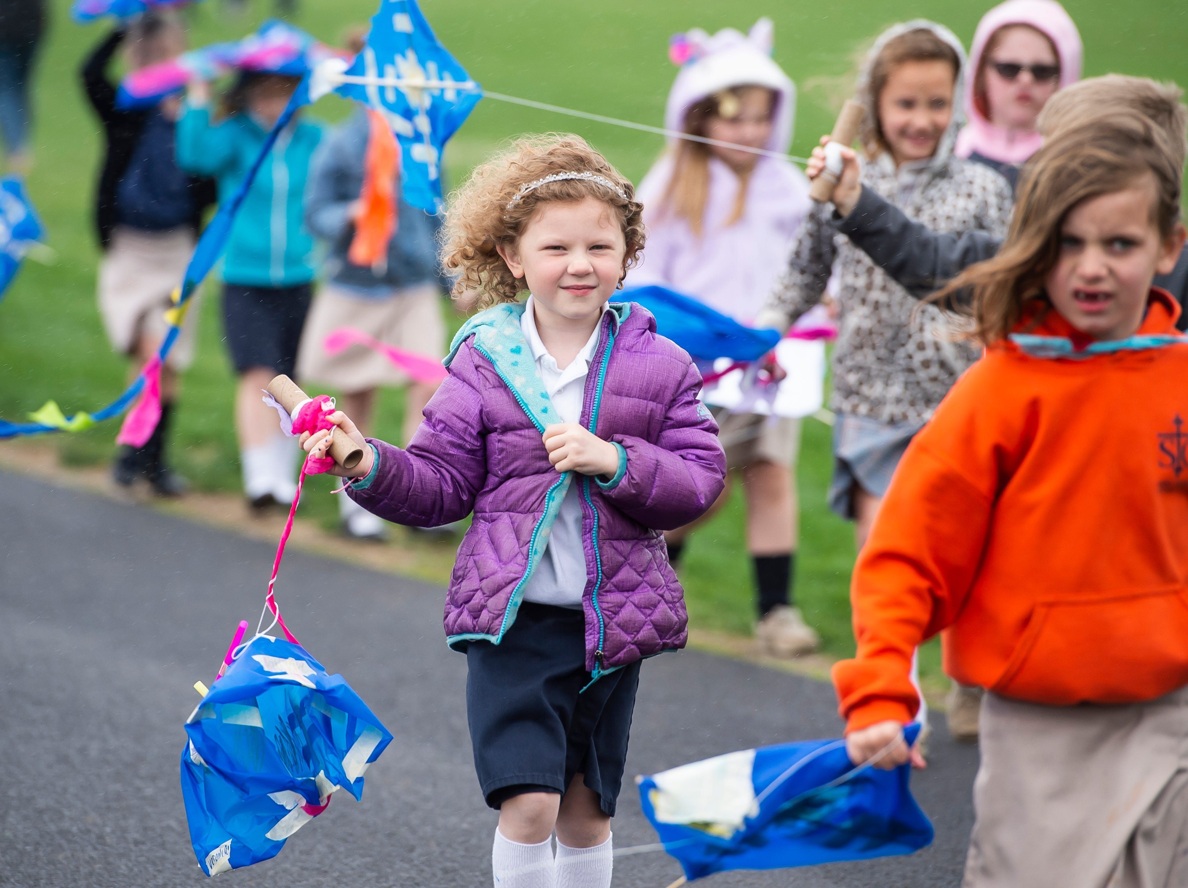 Students from St. Teresa of Calcutta Catholic School line up to head back inside after flying their homemade kites at the school's Conewago campus on Friday, April 12, 2019.
