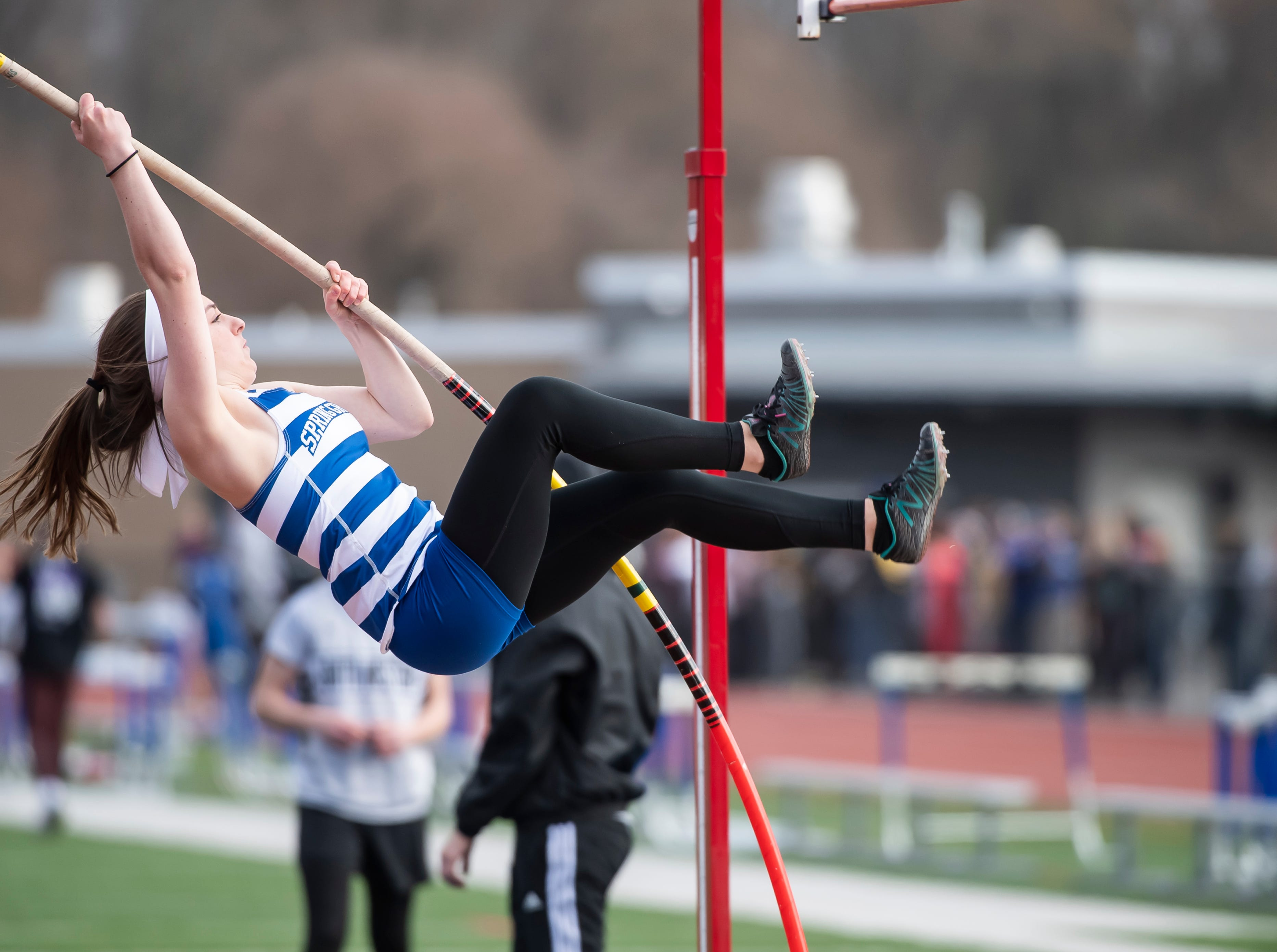 Spring Grove's Kasey Smith competes in the pole vault during a track and field meet against South Western on Thursday, April 11, 2019.