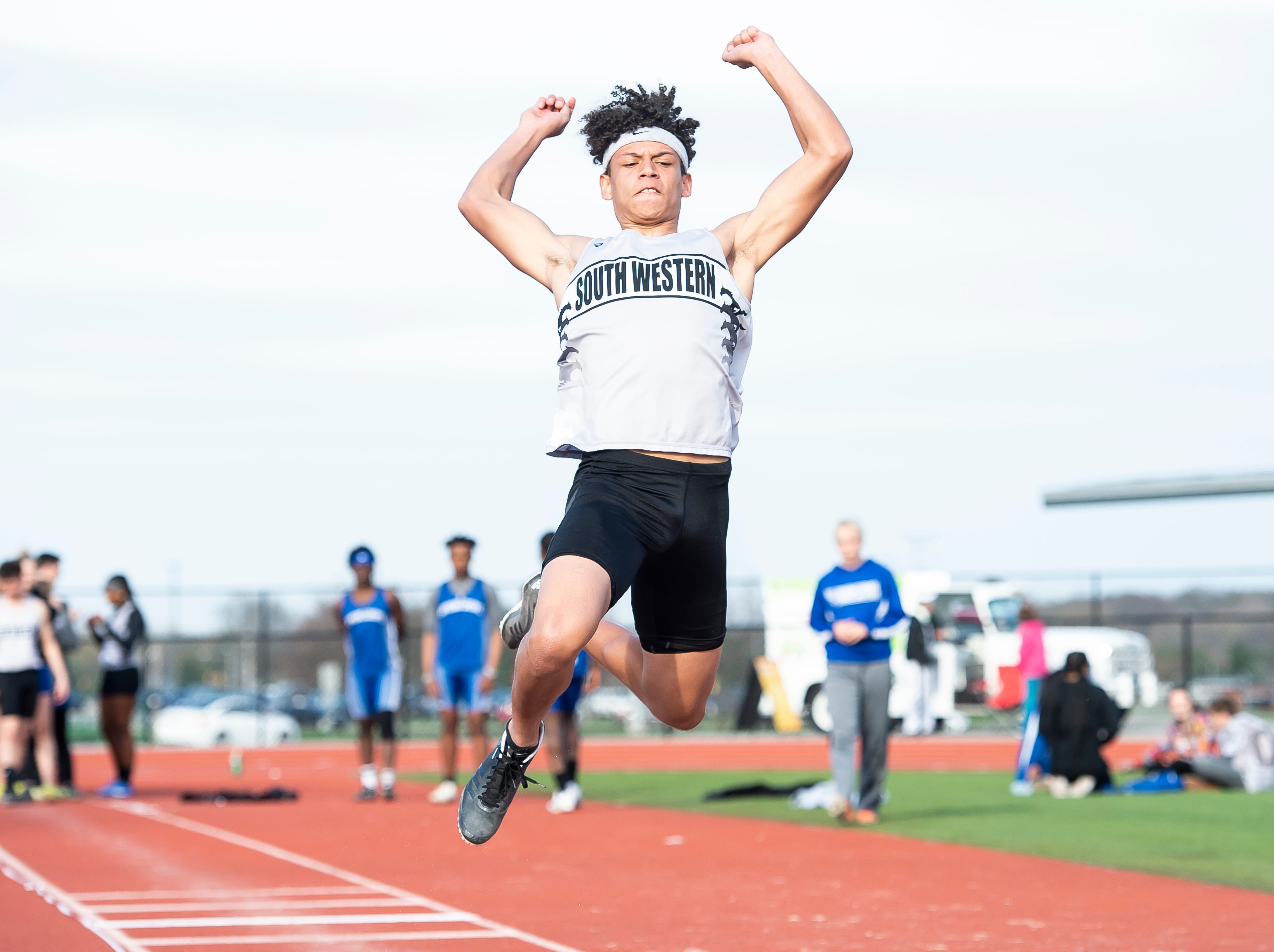 South Western's Jalen Bradford competes in the triple jump during a track and field meet against Spring Grove on Thursday, April 11, 2019.