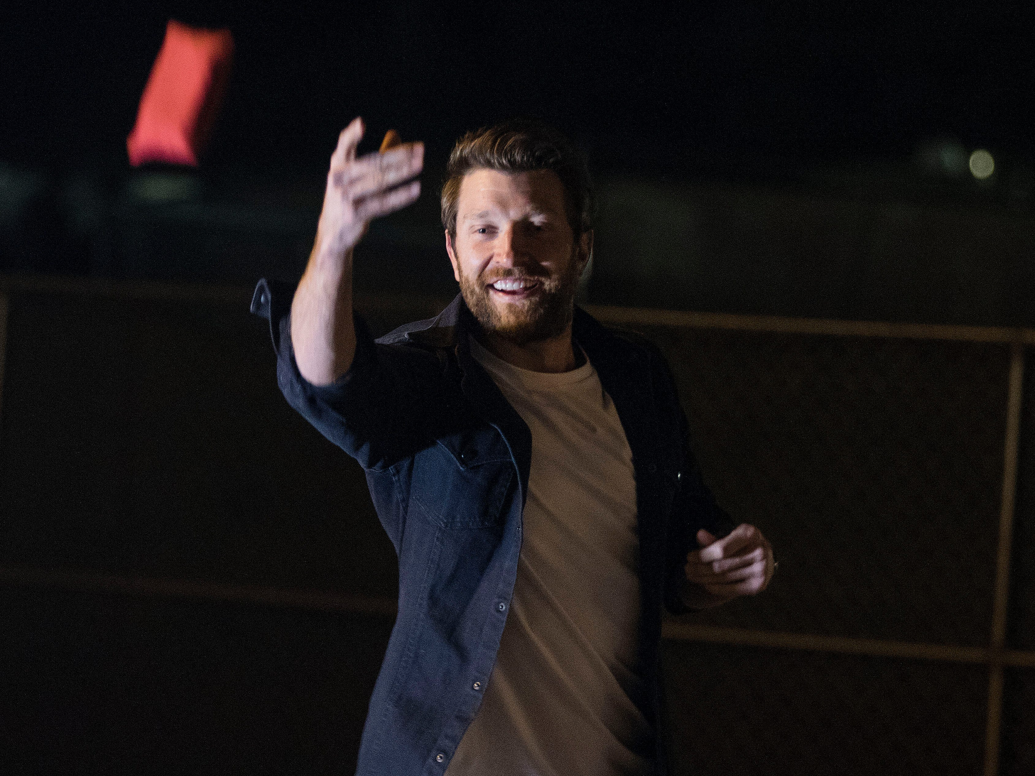 Country superstar Brett Eldredge tosses the game-winning beanbag as he plays a game of cornhole with a lucky young lady. Kayla Coffey of Tucson was picked from the audience for the chance meeting with Eldredge while at Country Thunder Arizona on April 11, 2019, in Florence, Ariz.