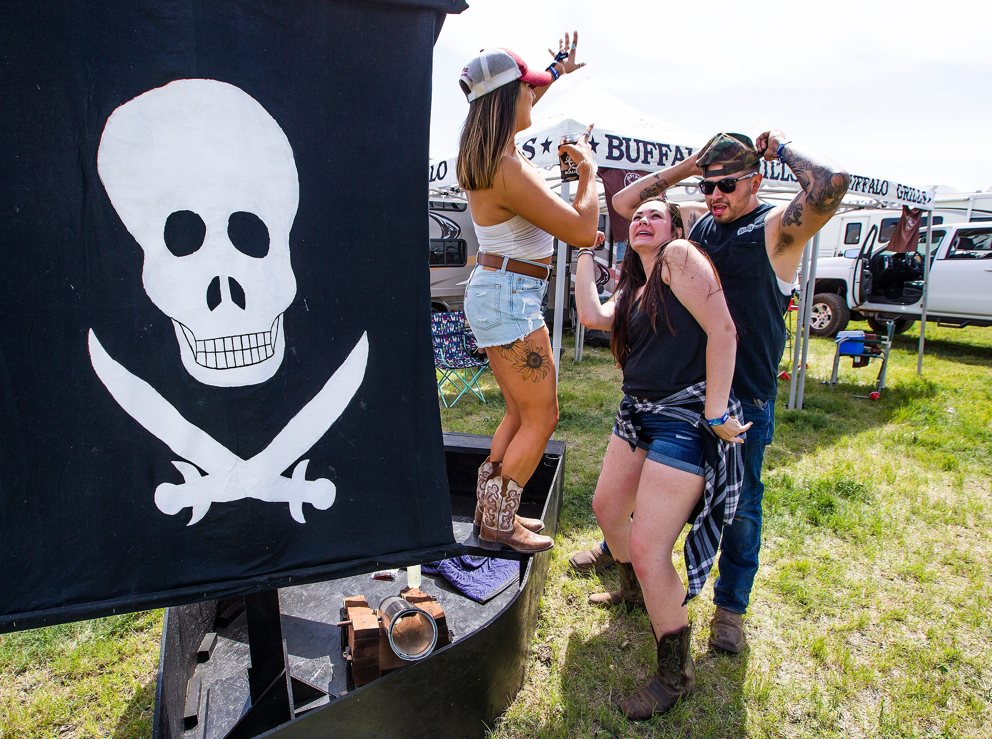 Samantha Weiss, 26, Chandler, Becca White, 27, Mesa, and Ron Borquez, 28, Tucson, dance at the Country Thunder Arizona 2019 music festival, Thursday , April 11, 2019.