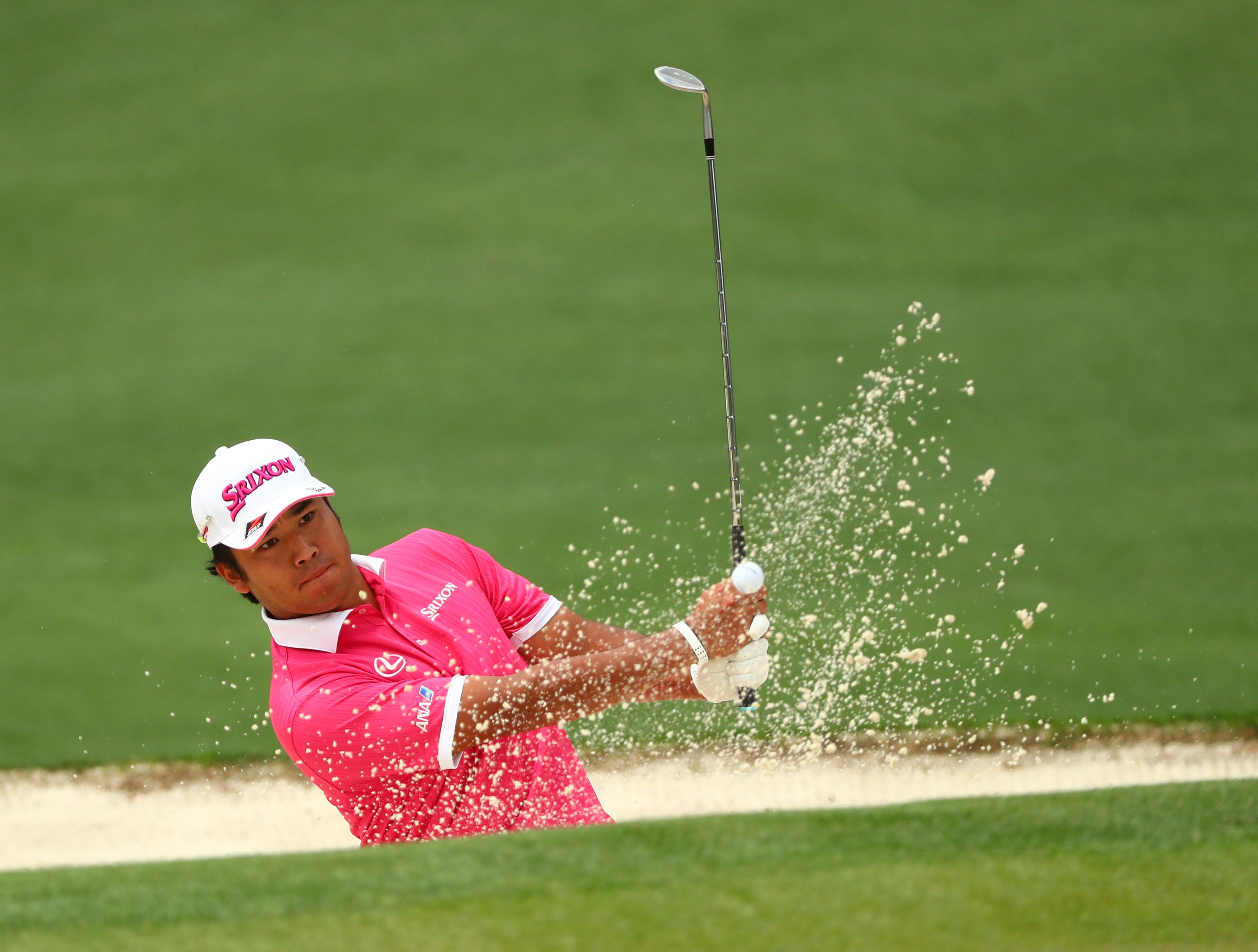 Apr 12, 2019; Augusta, GA, USA; Hideki Matsuyama hits out of a bunker on the 2nd hole during the second round of The Masters golf tournament at Augusta National Golf Club. Mandatory Credit: Rob Schumacher-USA TODAY Sports