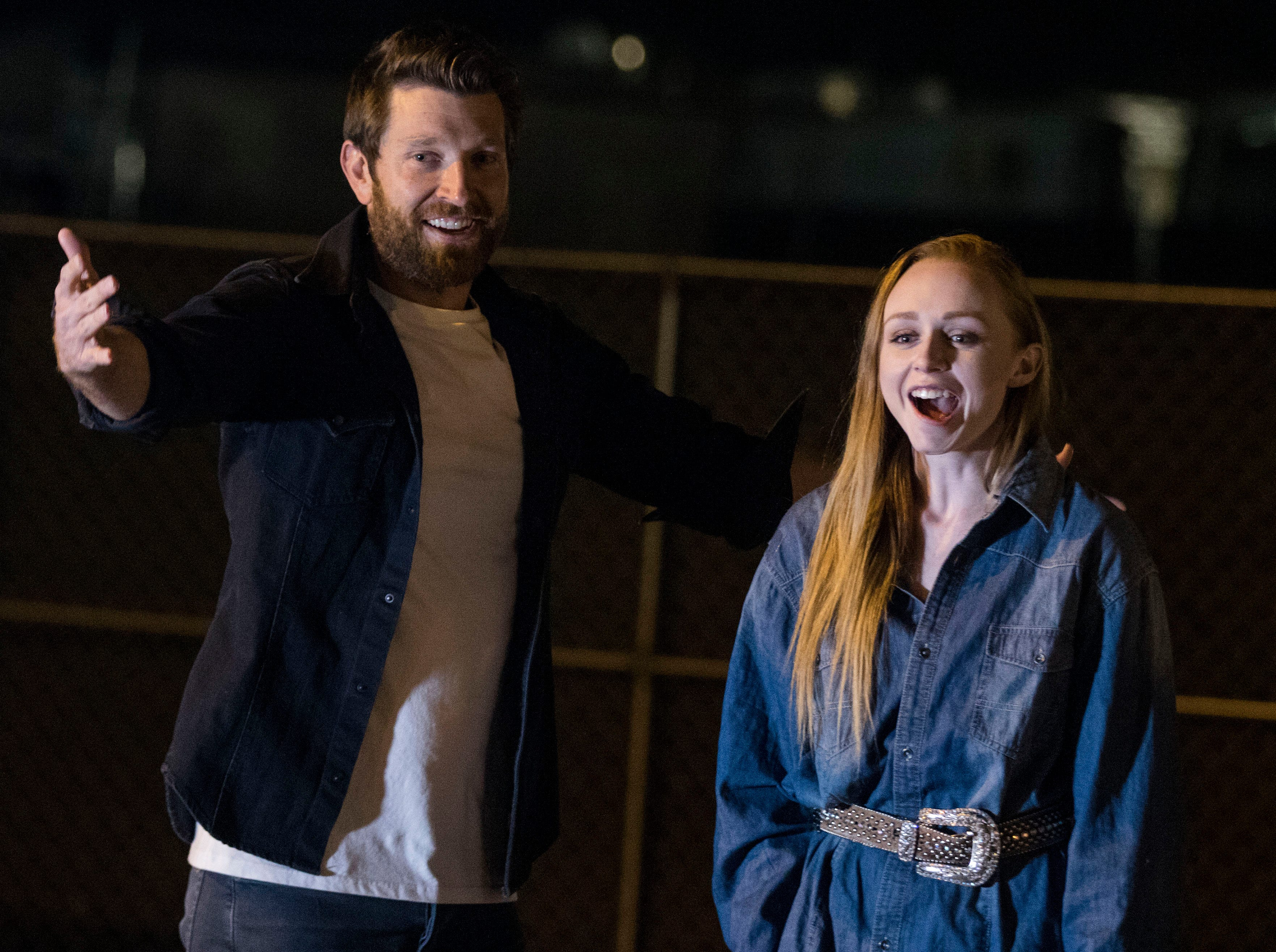 After sinking the game-winning shot, country superstar Brett Eldredge looks for a hug from Kayla Coffey of Tucson, who was picked from the audience for the chance meeting with Eldredge, while at Country Thunder Arizona on April 11, 2019, in Florence, Ariz.