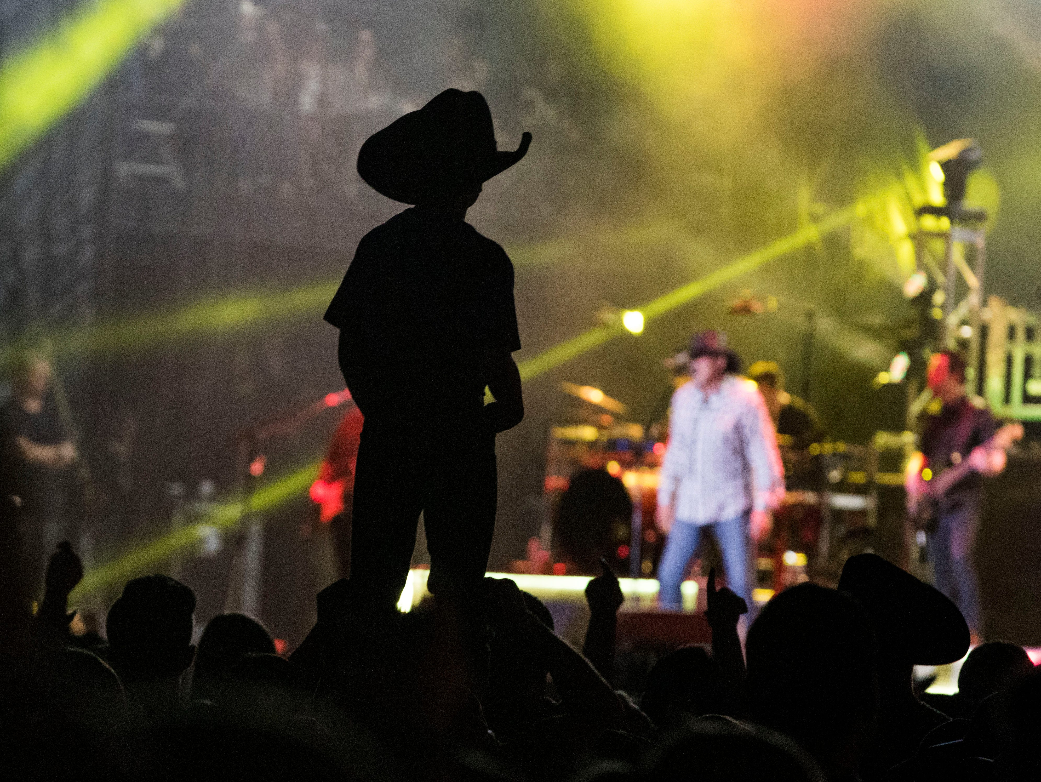 A little music fan gets a lift to get a better view of Trace Adkins during Country Thunder Arizona April 11, 2019, in Florence.