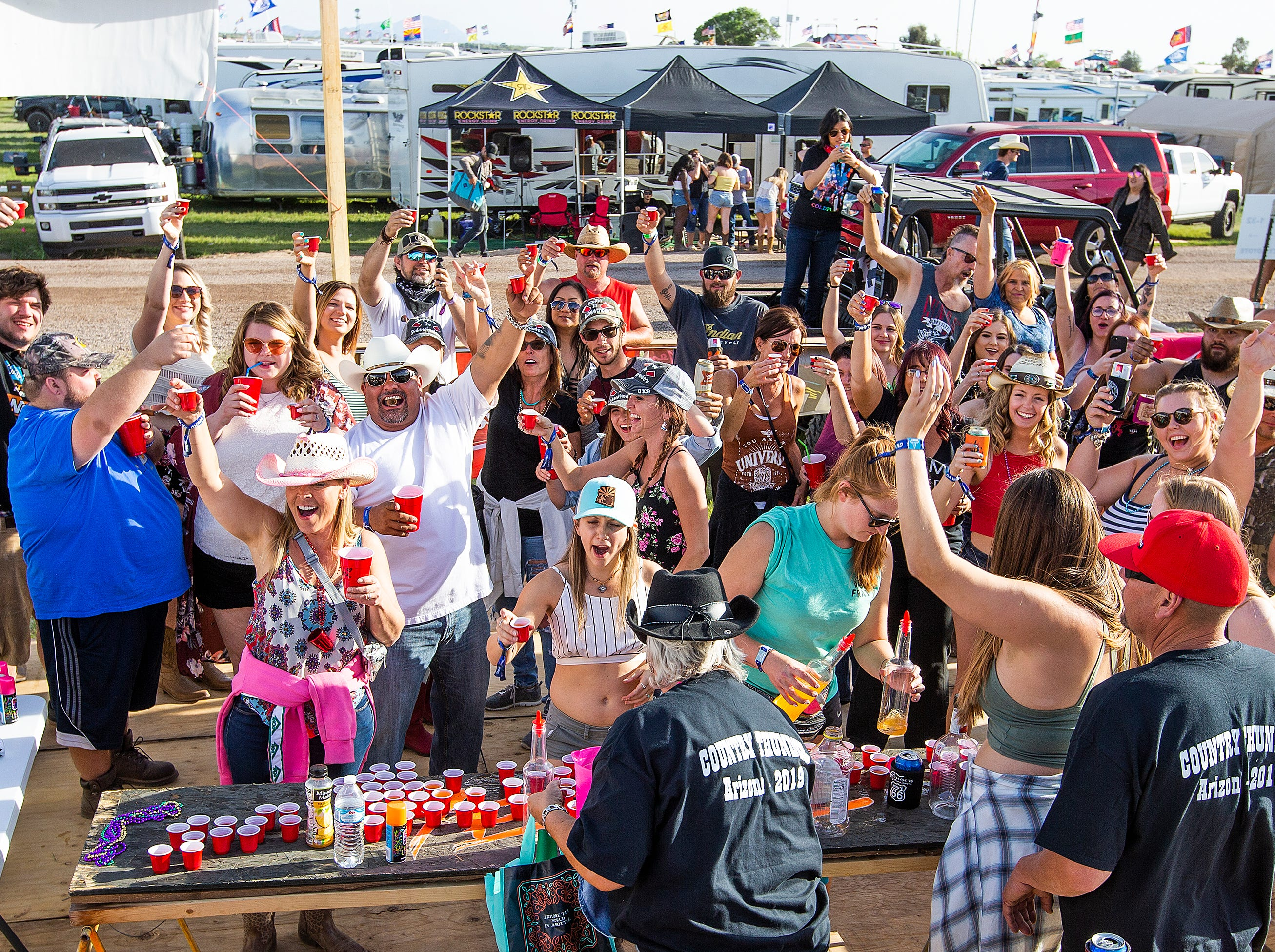 People make the first annual Country Thunder Arizona kickoff toast at Camp Burracho at the music festival on April 11, 2019.
