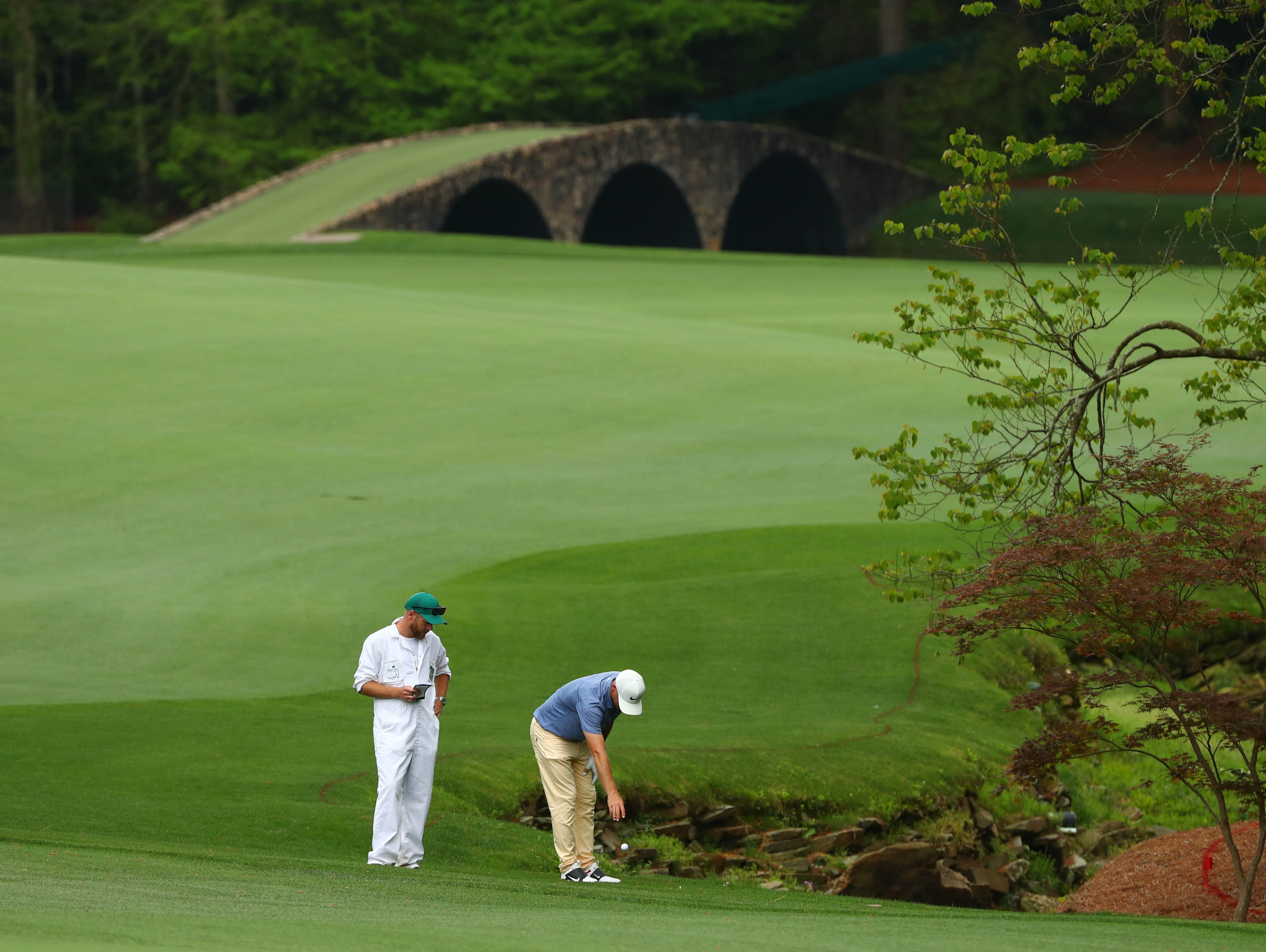 Apr 12, 2019; Augusta, GA, USA; Alex Noren takes a drop on the 13th hole with the Hogan Bridge in the background during the second round of The Masters golf tournament at Augusta National Golf Club. Mandatory Credit: Rob Schumacher-USA TODAY Sports