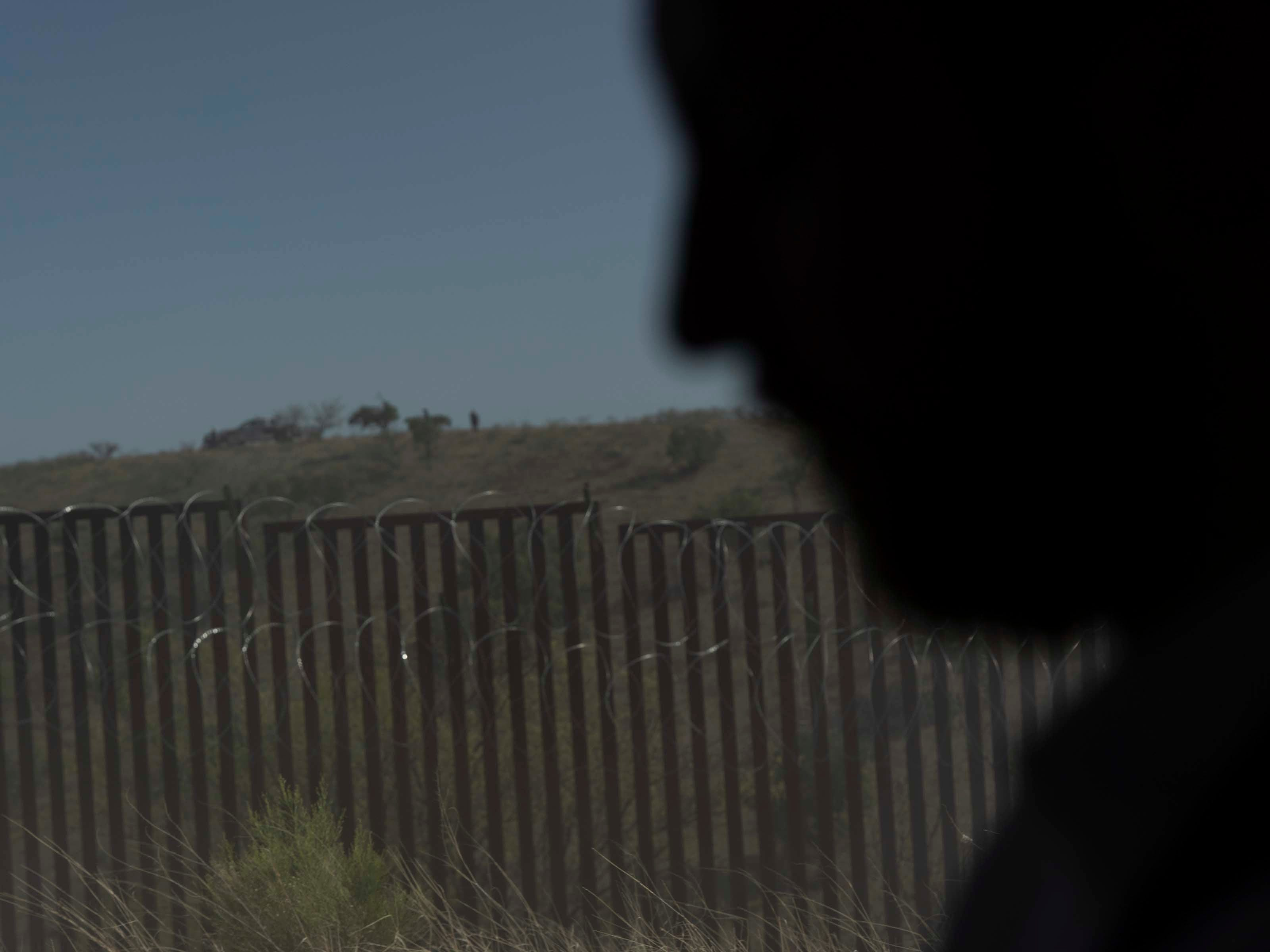 A Border Patrol agent watches Vice President Mike Pence and Arizona Gov. Doug Ducey's motorcade near the U.S.-Mexico border fence in Nogales, Ariz.