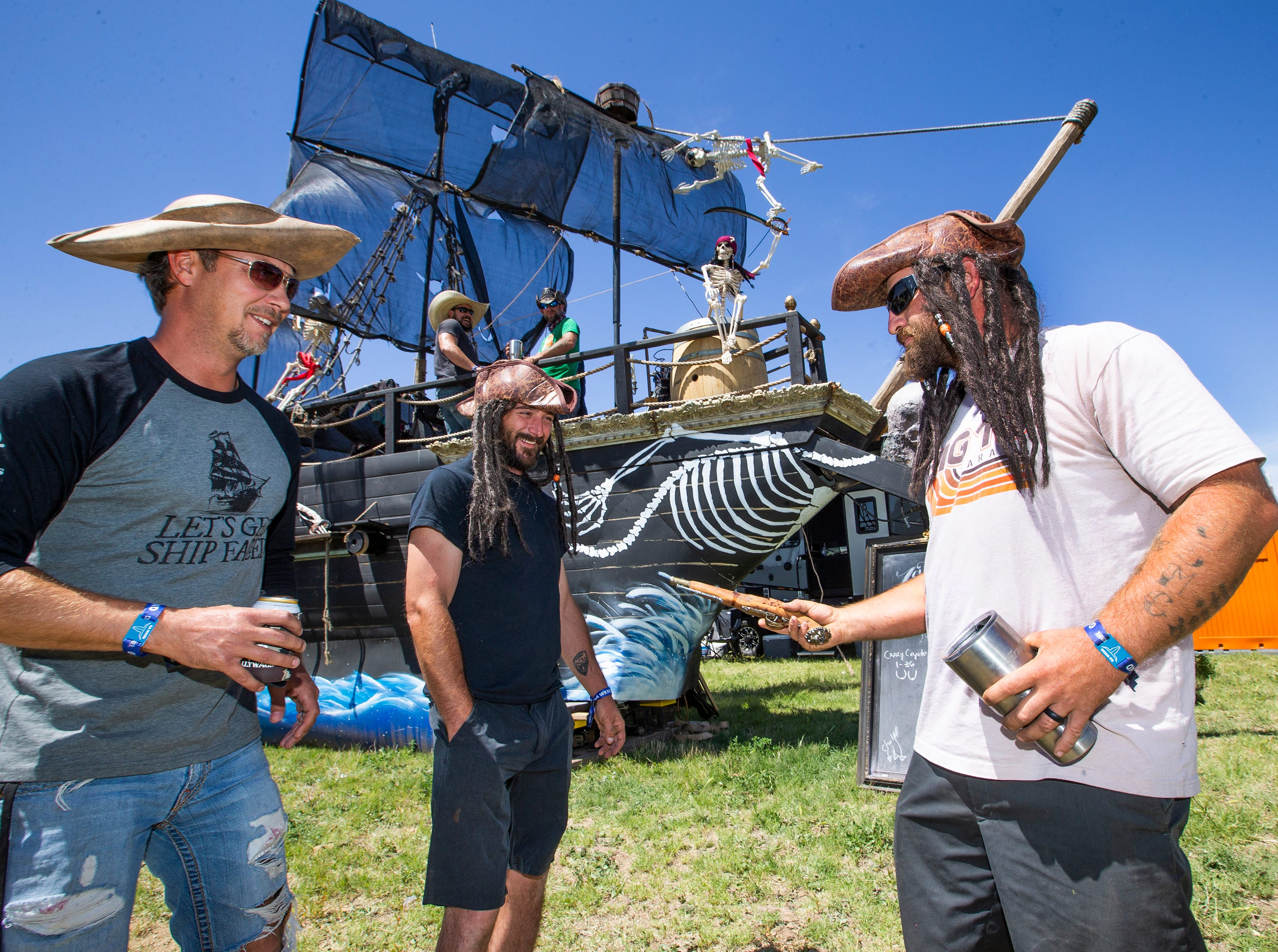 A pirate ship, built by Sean Franklin, 41, Queen Creek, left, Rich Reeves, 32, Mesa, and Christian Zeitler, 34, Queen Creek, is a hit at Country Thunder Arizona 2019 near Florence, Thursday, April 11, 2019. The ship has cannons that shoot water and a bar.