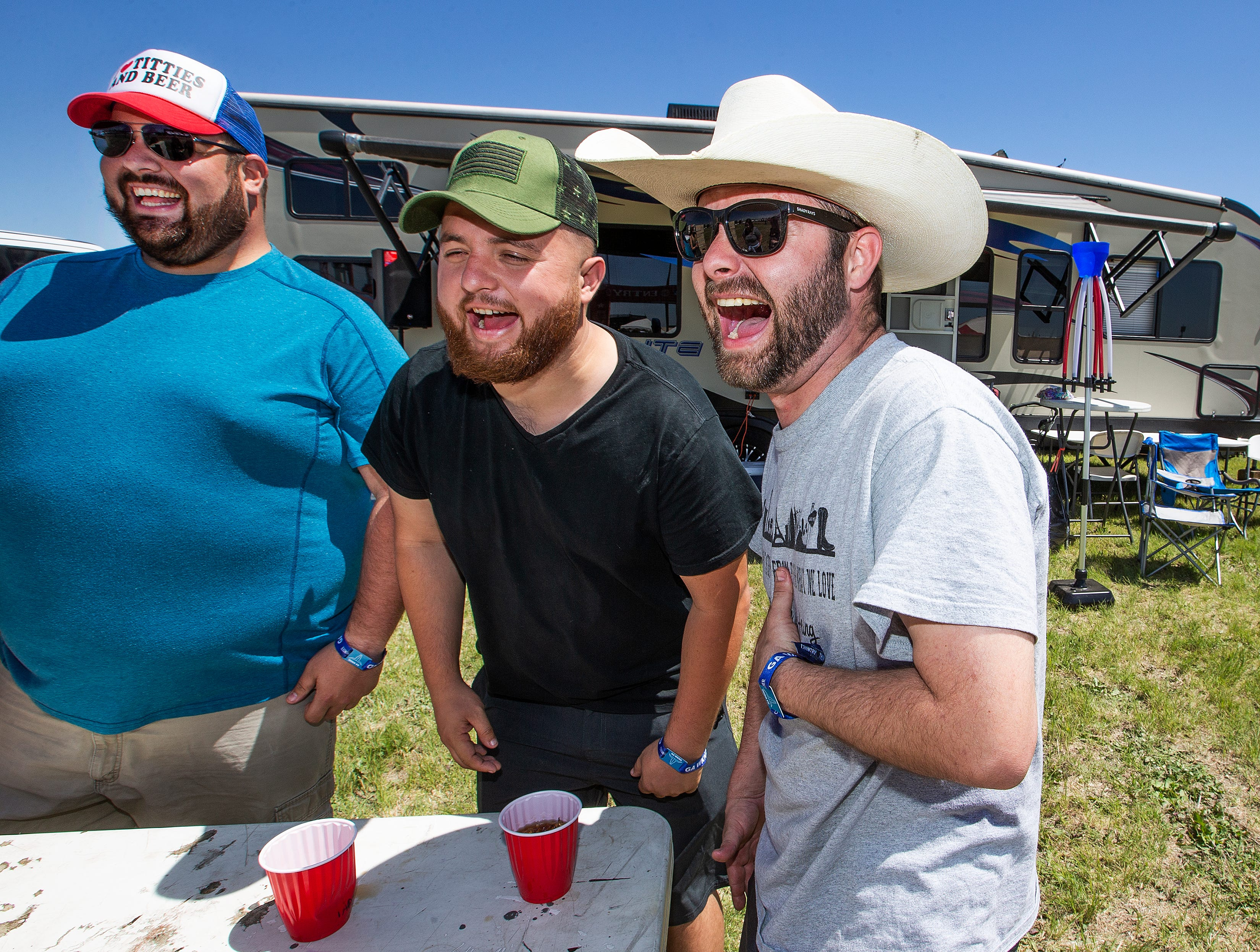 Patrick Feezell, 29, Chandler, Josh Rivera, 28, Phoenix, and Joseph Weaver,28, Henderson, Nevada, have fun at Country Thunder Arizona 2019 Thursday, April 11, 2019.