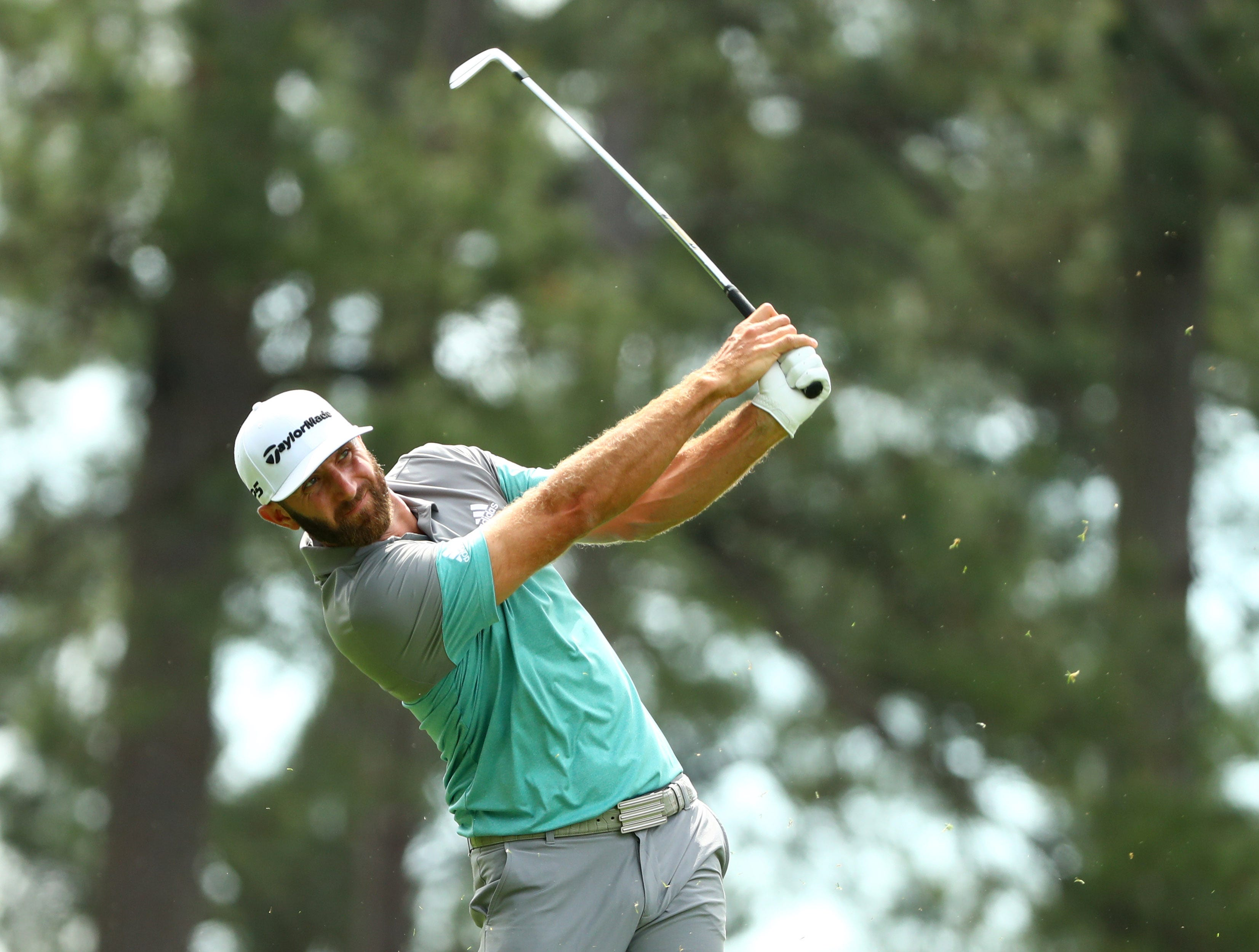 Apr 12, 2019; Augusta, GA, USA; Dustin Johnson hits his tee shot on the 4th hole during the second round of The Masters golf tournament at Augusta National Golf Club. Mandatory Credit: Rob Schumacher-USA TODAY Sports