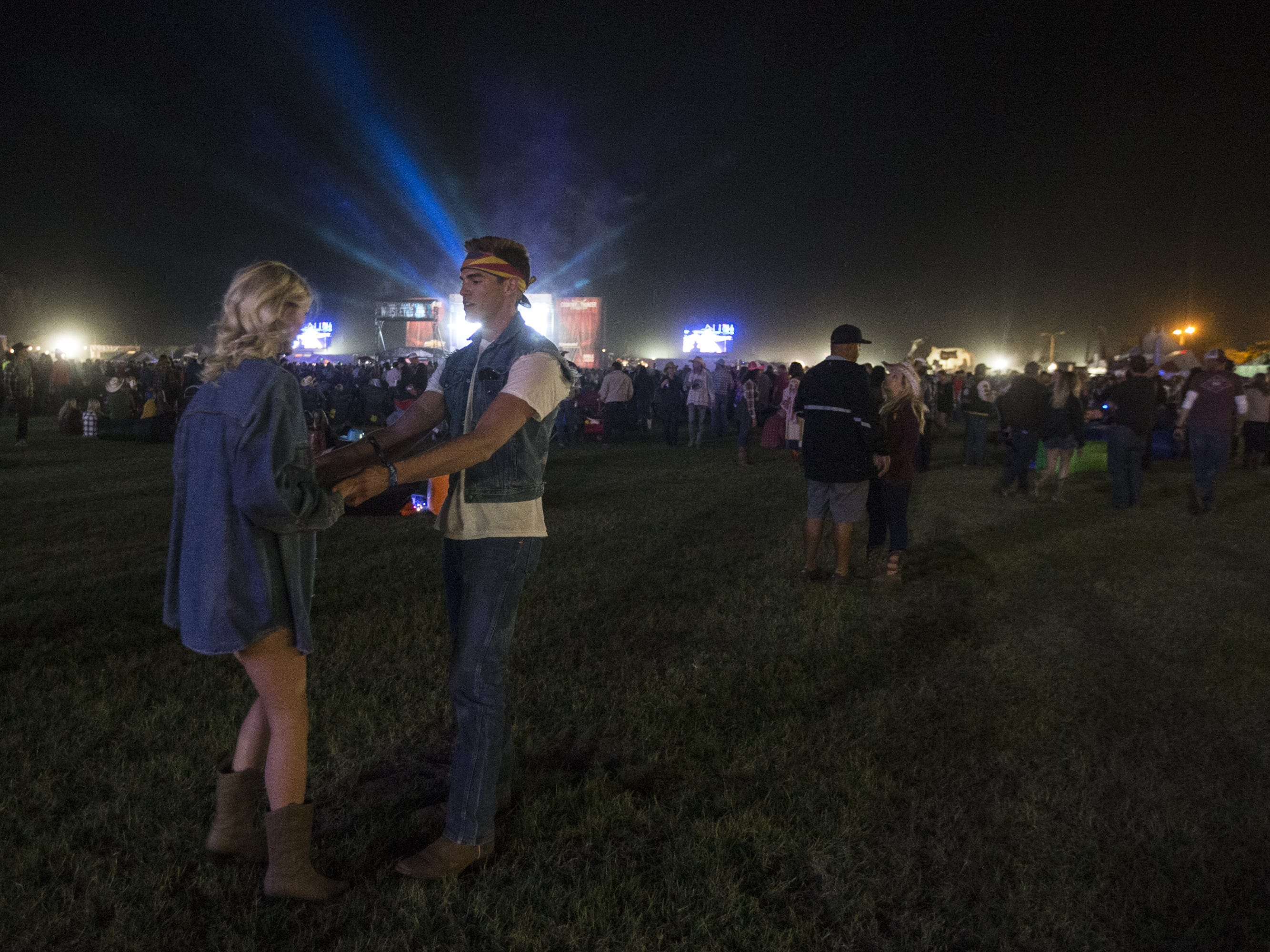 Tanner Koons and Audrey Lyon dance while Trace Adkins performs on April 11, 2019, during Day 1 of Country Thunder Arizona in Florence.