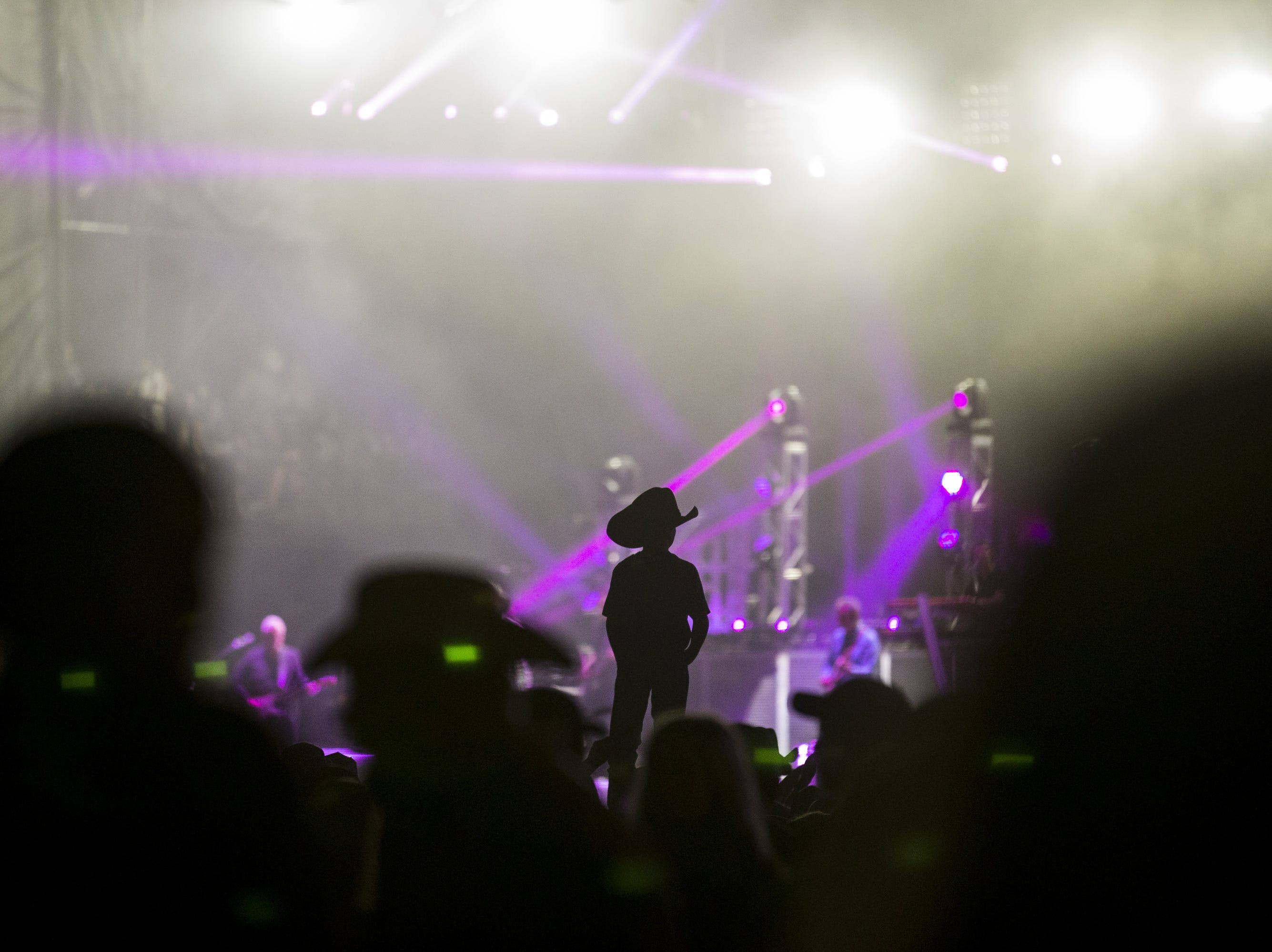 A boy watches Trace Adkins perform on April 11, 2019, during Day 1 of Country Thunder Arizona in Florence.