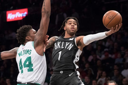 Nets guard D'Angelo Russell drives to the basket during a game on March 30.