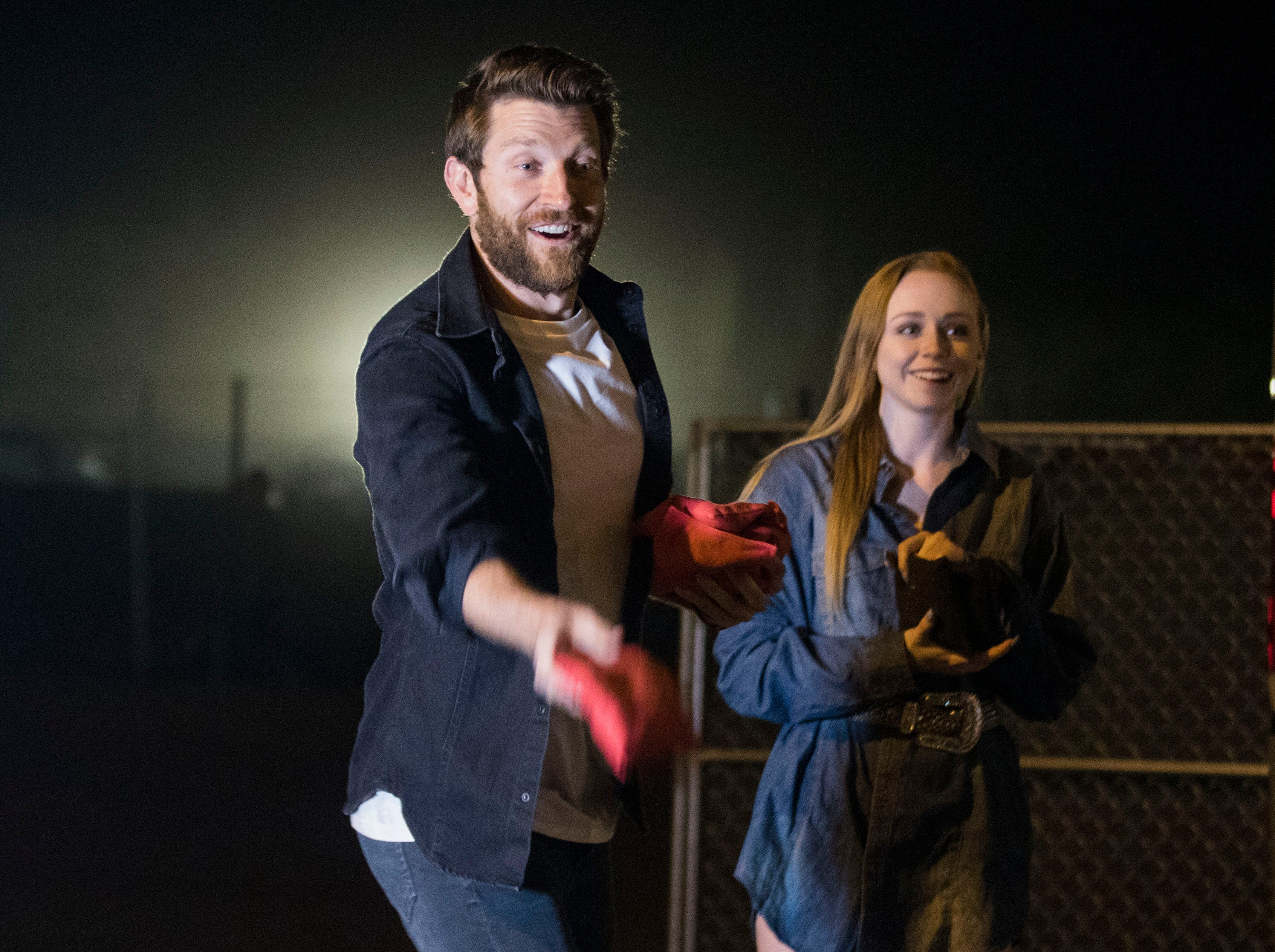 Country superstar Brett Eldredge plays a game of cornhole with a lucky young lady. Kayla Coffey of Tucson was picked from the audience for the chance meeting with Eldredge while at Country Thunder Arizona on April 11, 2019, in Florence, Ariz.