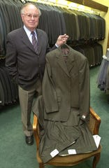 Wayne Pomeroy displays his famous two-pant suit which is popular among Mormon missionaries during his store's 50th anniversary.