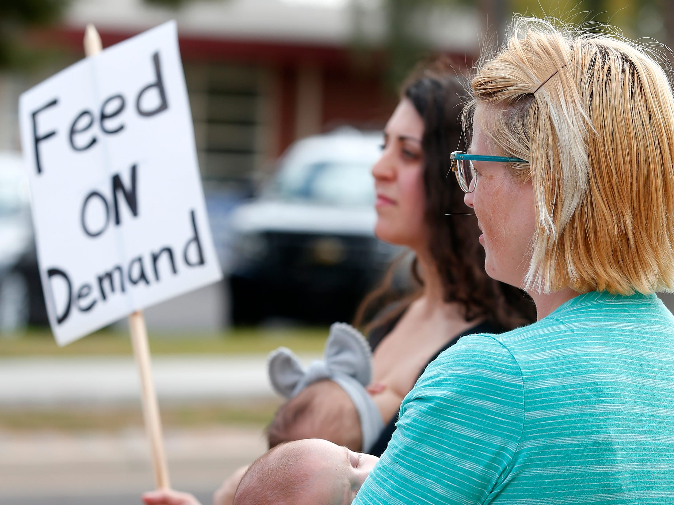 Theresa Phillips and her son, Otto, 11 weeks, participate in a nurse-in after Phillips was confronted by school administrators for breastfeeding at Kiva Elementary in Paradise Valley.
