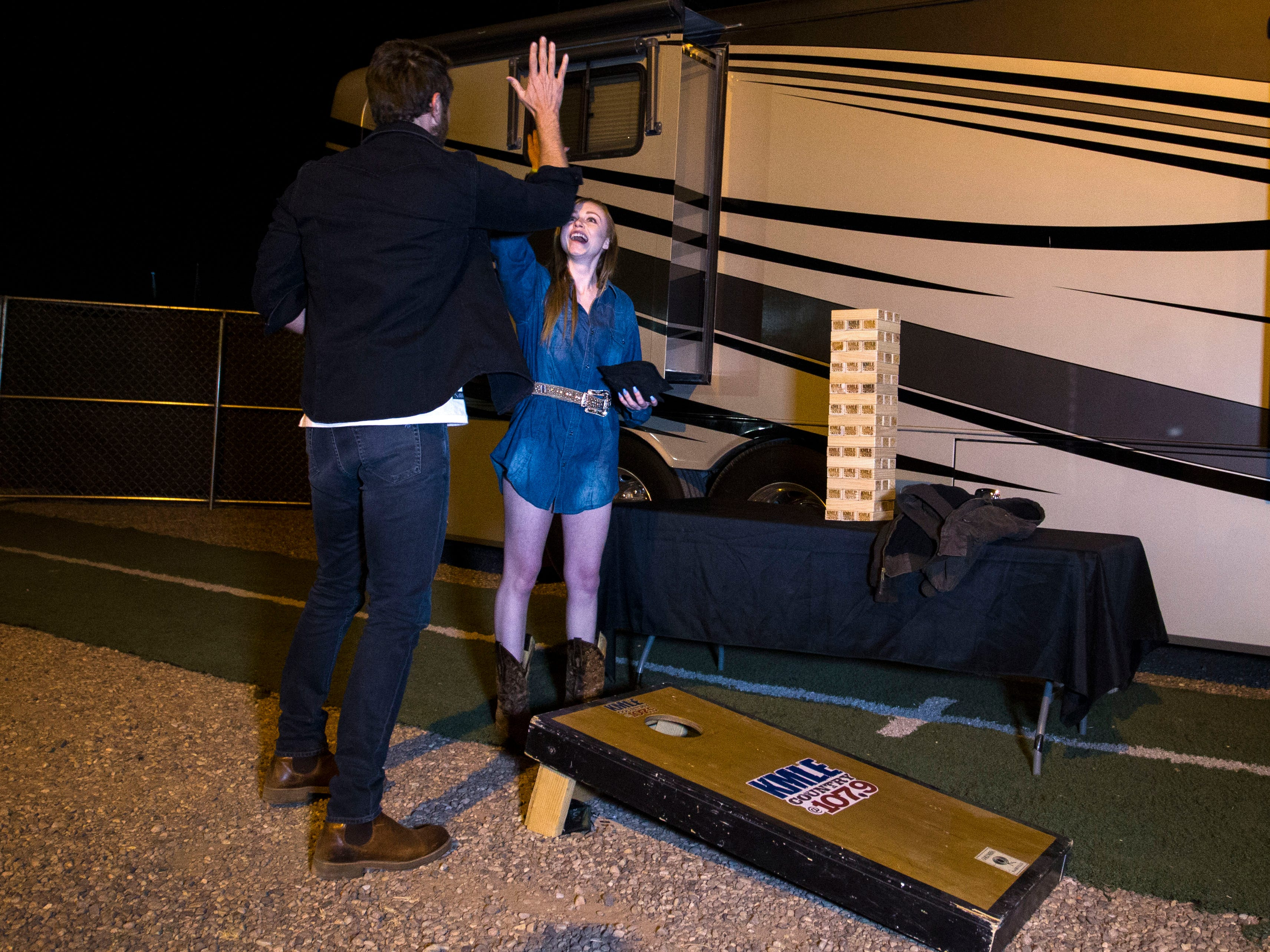 Country superstar Brett Eldredge high-fives his teammate Kayla Coffey of Tucson, who was picked from the audience for the chance meeting with Eldredge while at Country Thunder Arizona on April 11, 2019, in Florence, Ariz.