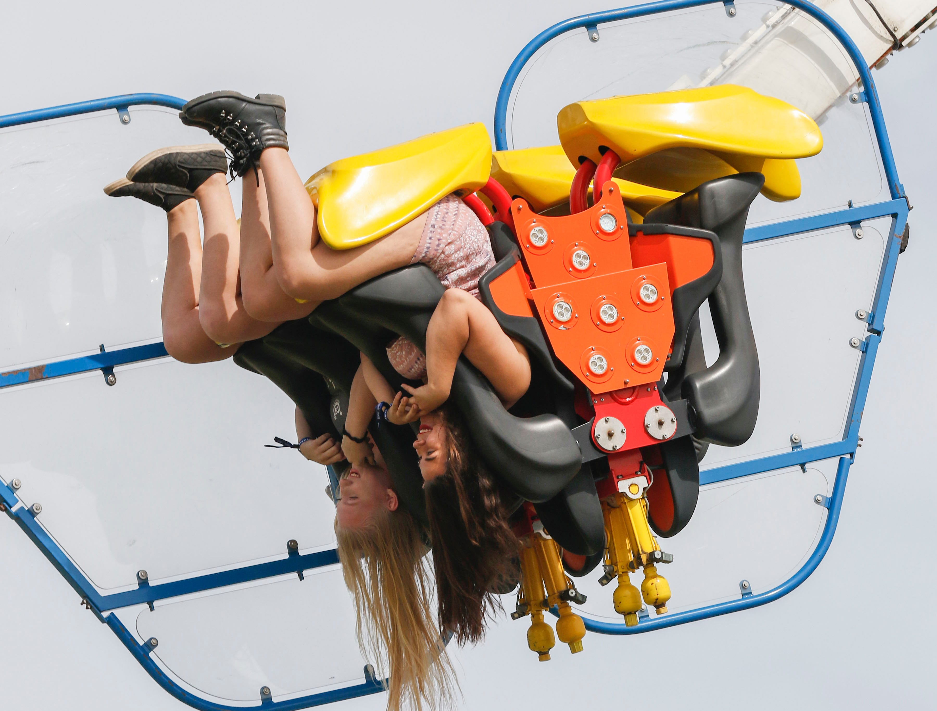 Goodyear's Jackie Steinman (left) and Chandler's Angel Ezell (right) have a hair-raising experience on Speed during Country Thunder Arizona on April 11, 2019, in Florence, Arizona.