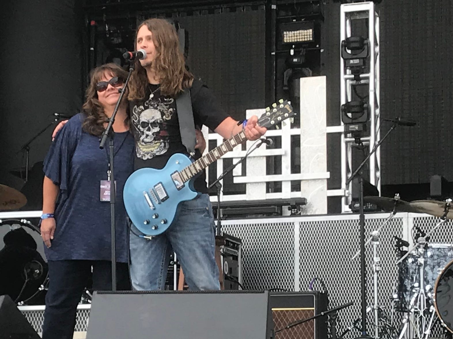 Singer-guitarist TJ Taylor of the Cole Trains hugs his mother after bringing both parents on stage to do a song with them.
