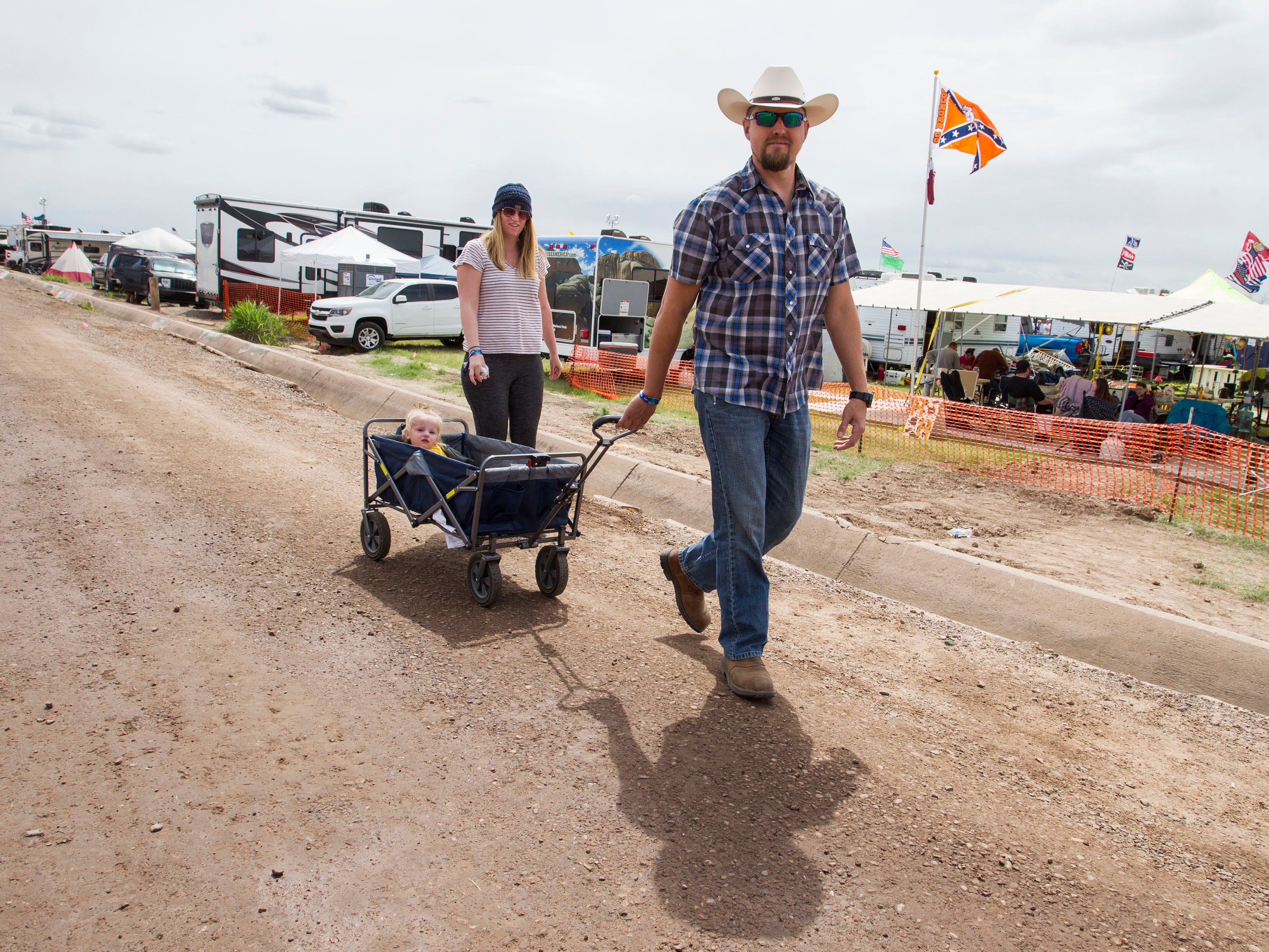 Skull Valley's 18 month-old Savannah Moxdziock gets a ride from mom and dad Jessie and Joe during Country Thunder Arizona on  April 12, 2019, in Florence, Ariz.