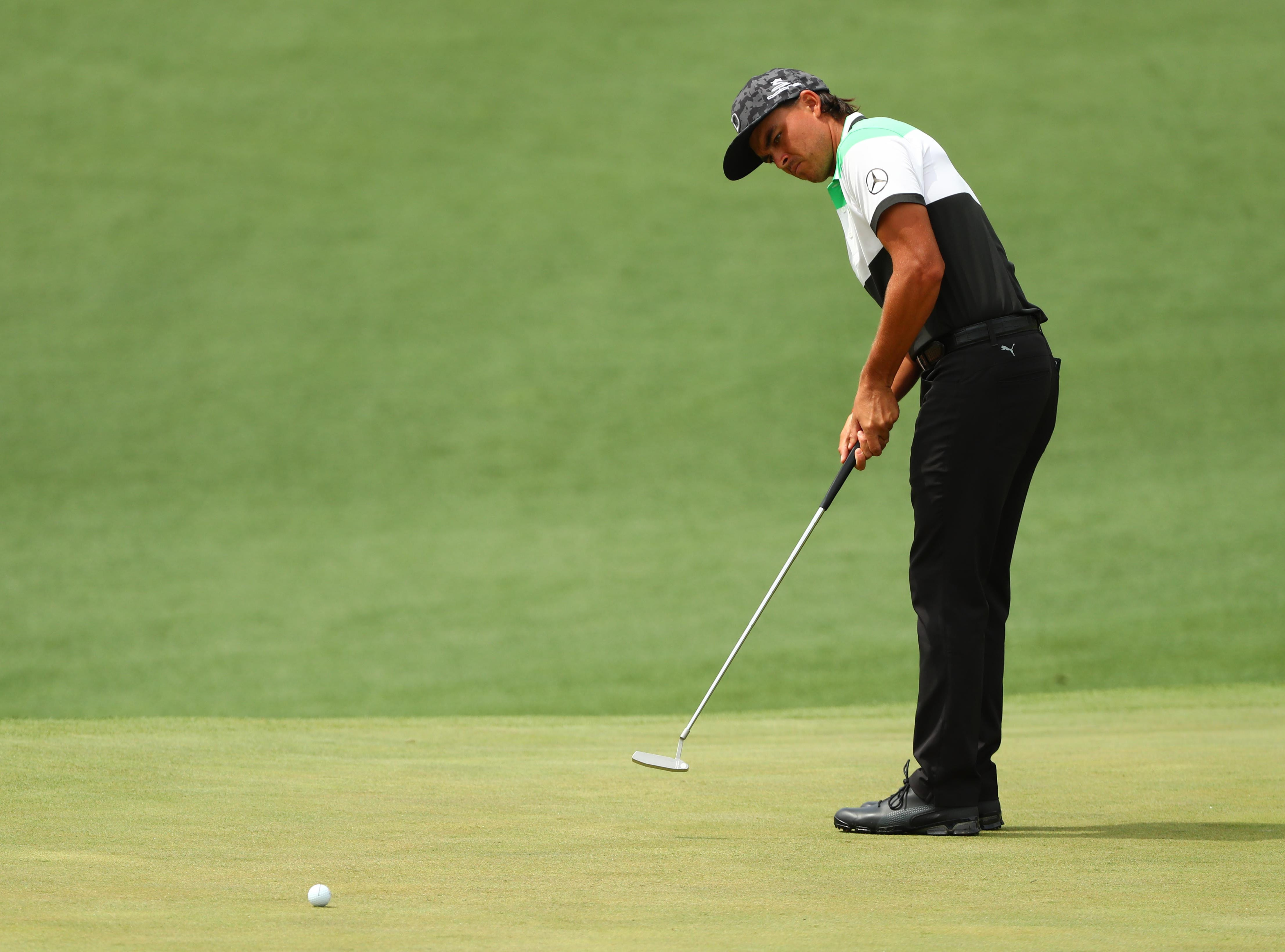 Apr 12, 2019; Augusta, GA, USA; Rickie Fowler putts on the 2nd green during the second round of The Masters golf tournament at Augusta National Golf Club. Mandatory Credit: Rob Schumacher-USA TODAY Sports