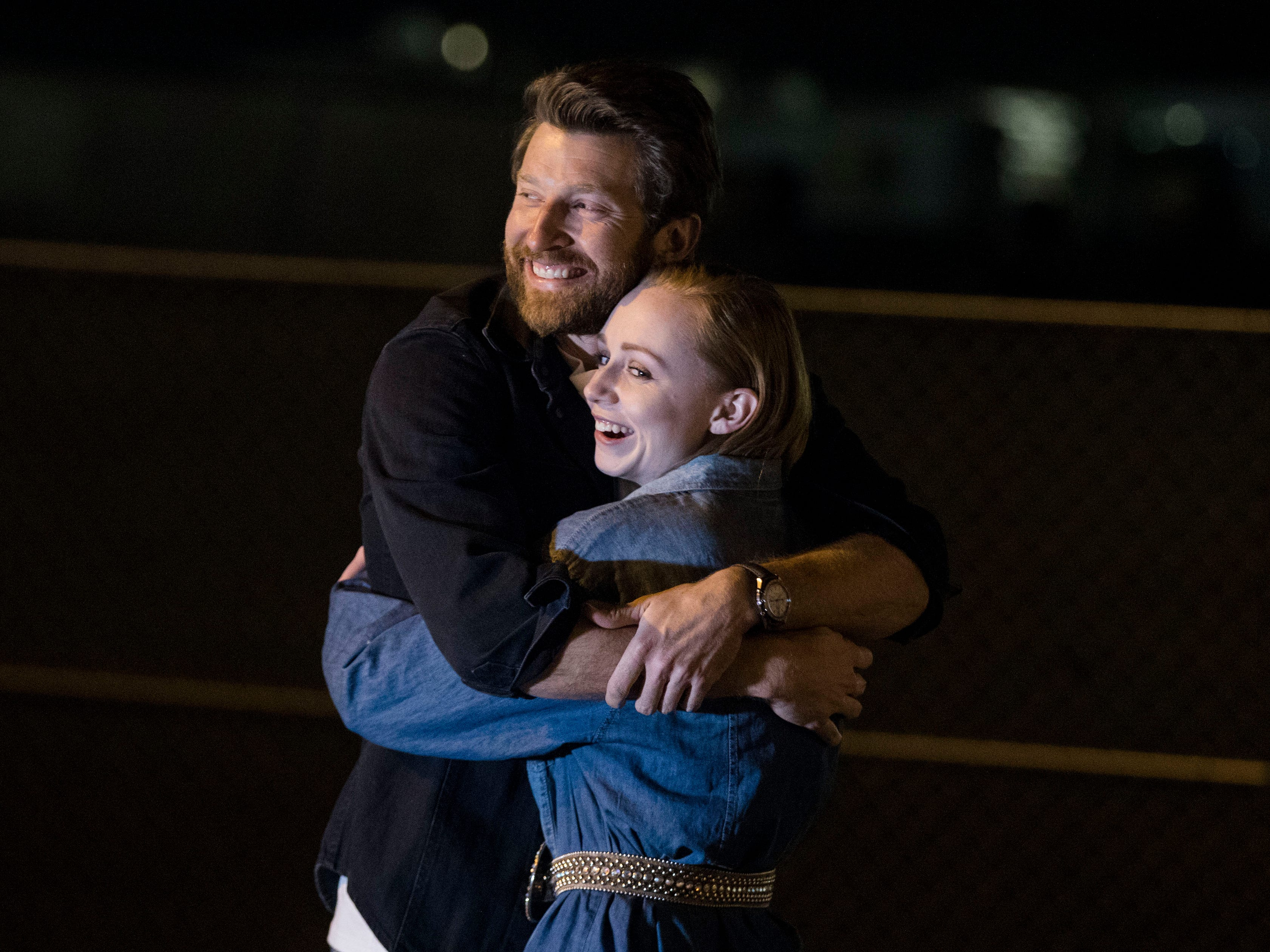 After sinking the game-winning shot, country superstar Brett Eldredge hugs Kayla Coffey of Tucson, who was picked from the audience for the chance meeting with Eldredge, while at Country Thunder Arizona on April 11, 2019, in Florence, Ariz.