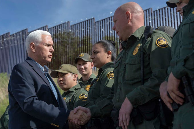 Vice President Mike Pence with Arizona Gov. Doug Ducey, along with Border Patrol agents, tour sections of the border fence in Nogales, Ariz.