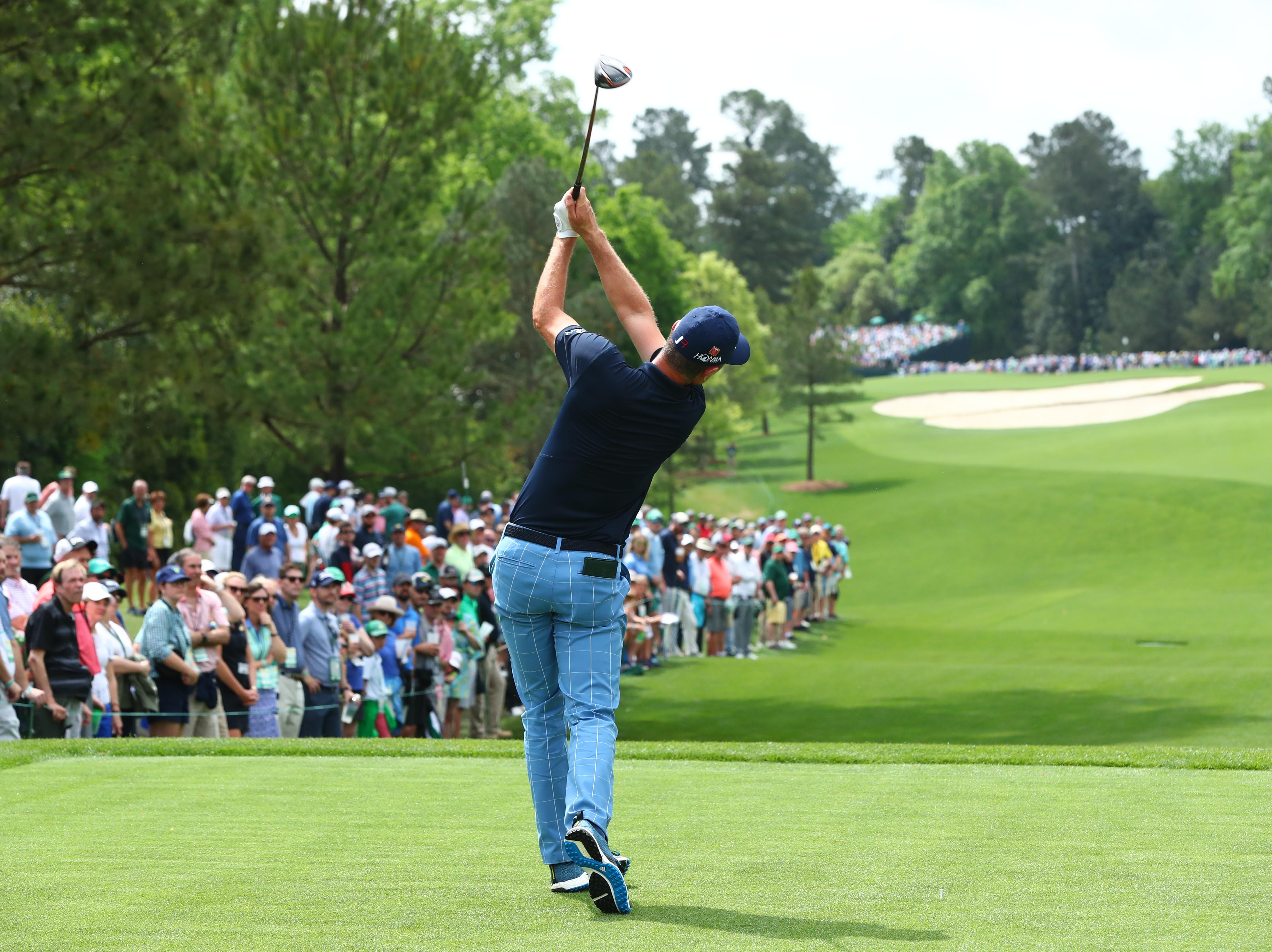 Apr 12, 2019; Augusta, GA, USA; Justin Rose hits his tee shot on the 5th hole during the second round of The Masters golf tournament at Augusta National Golf Club. Mandatory Credit: Rob Schumacher-USA TODAY Sports
