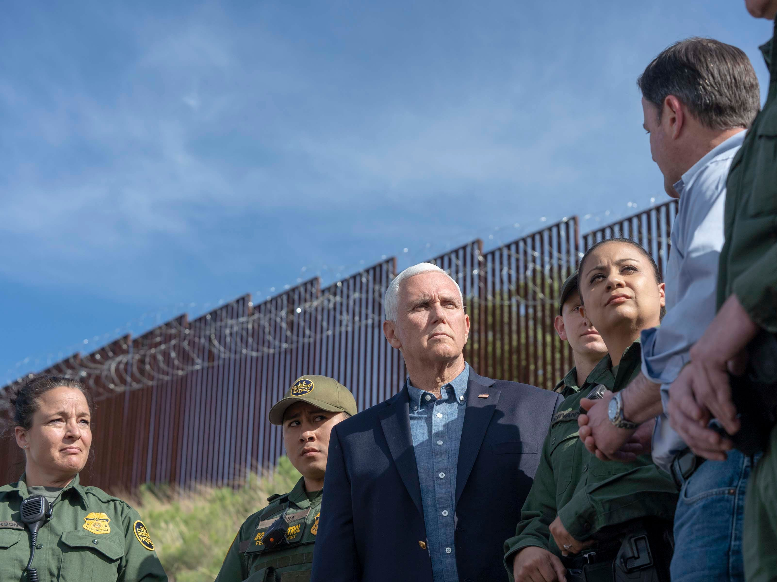 Vice President Mike Pence and Arizona Gov. Doug Ducey, along with Border Patrol agents, tour sections of the border fence in Nogales, Ariz.