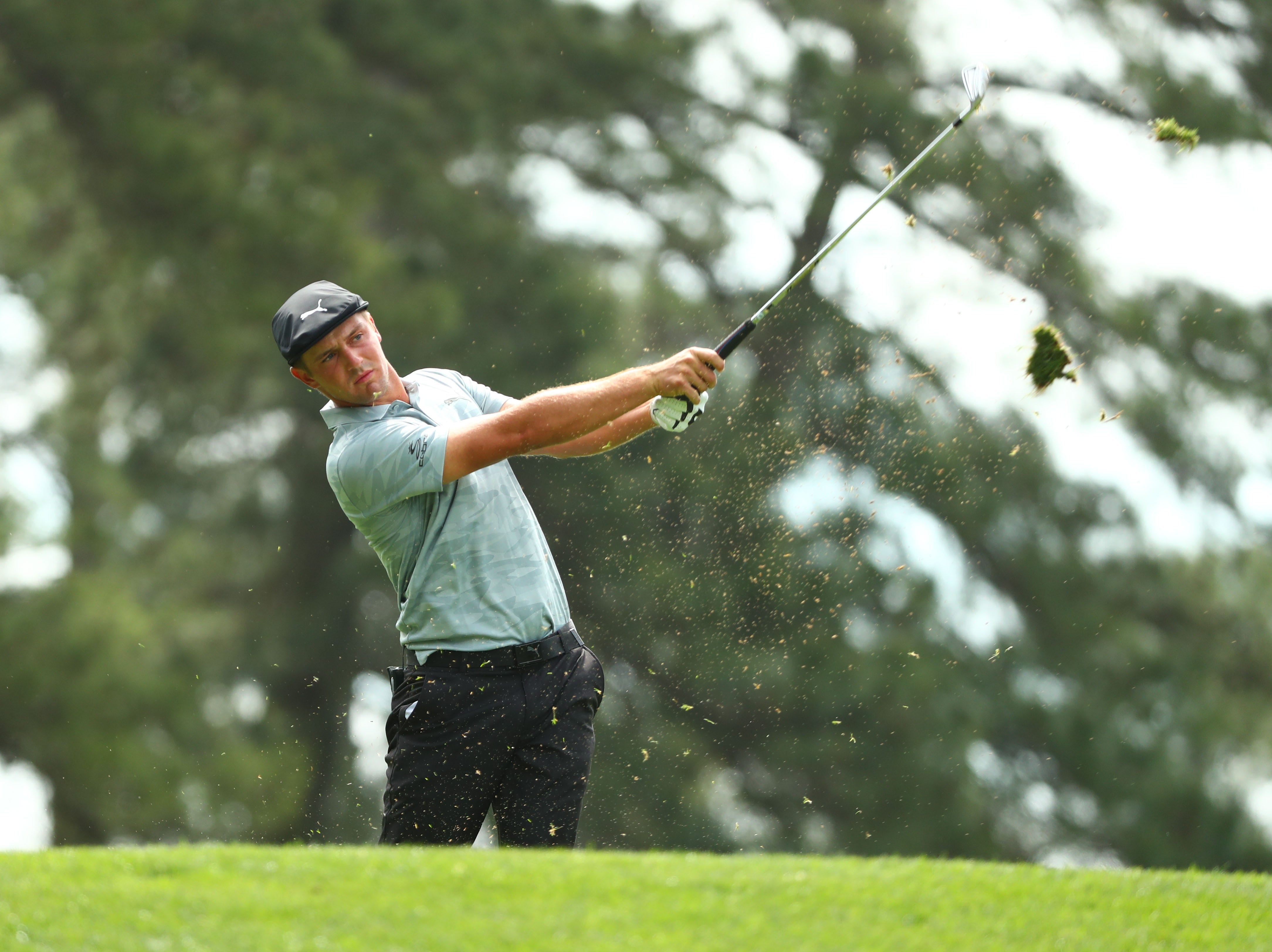 Apr 12, 2019; Augusta, GA, USA; Bryson DeChambeau hits his tee shot on the 4th hole during the second round of The Masters golf tournament at Augusta National Golf Club. Mandatory Credit: Rob Schumacher-USA TODAY Sports
