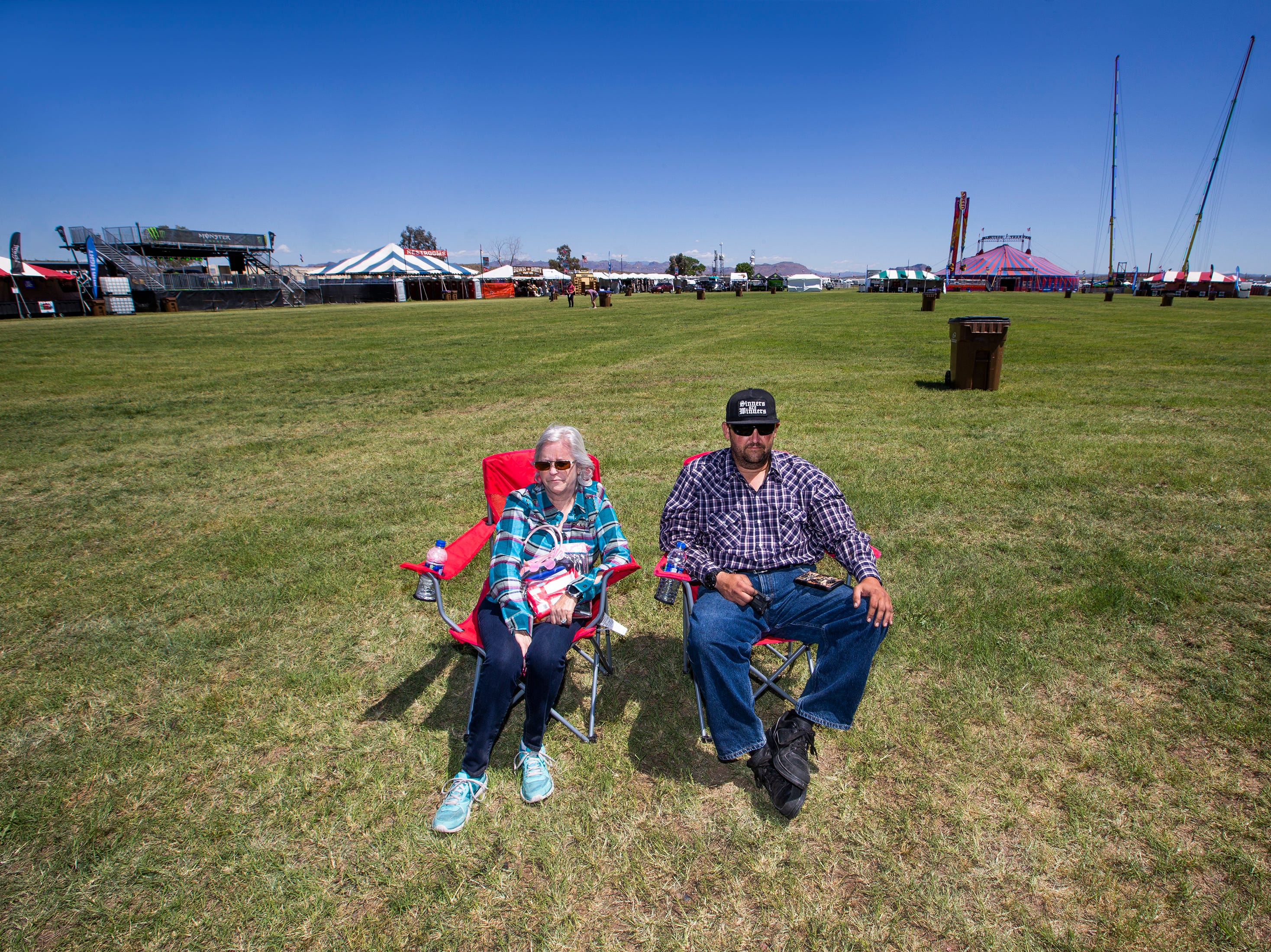 The first two people to claim their spots near the stage for the concert at Country Thunder Arizona 2019 Thursday morning were Marian Scott, 66, and her son, Kenneth Scott, Jr., 42, both of Tucson. They set up their chairs at 9:15 am.  This is their first time coming to the country music festival.