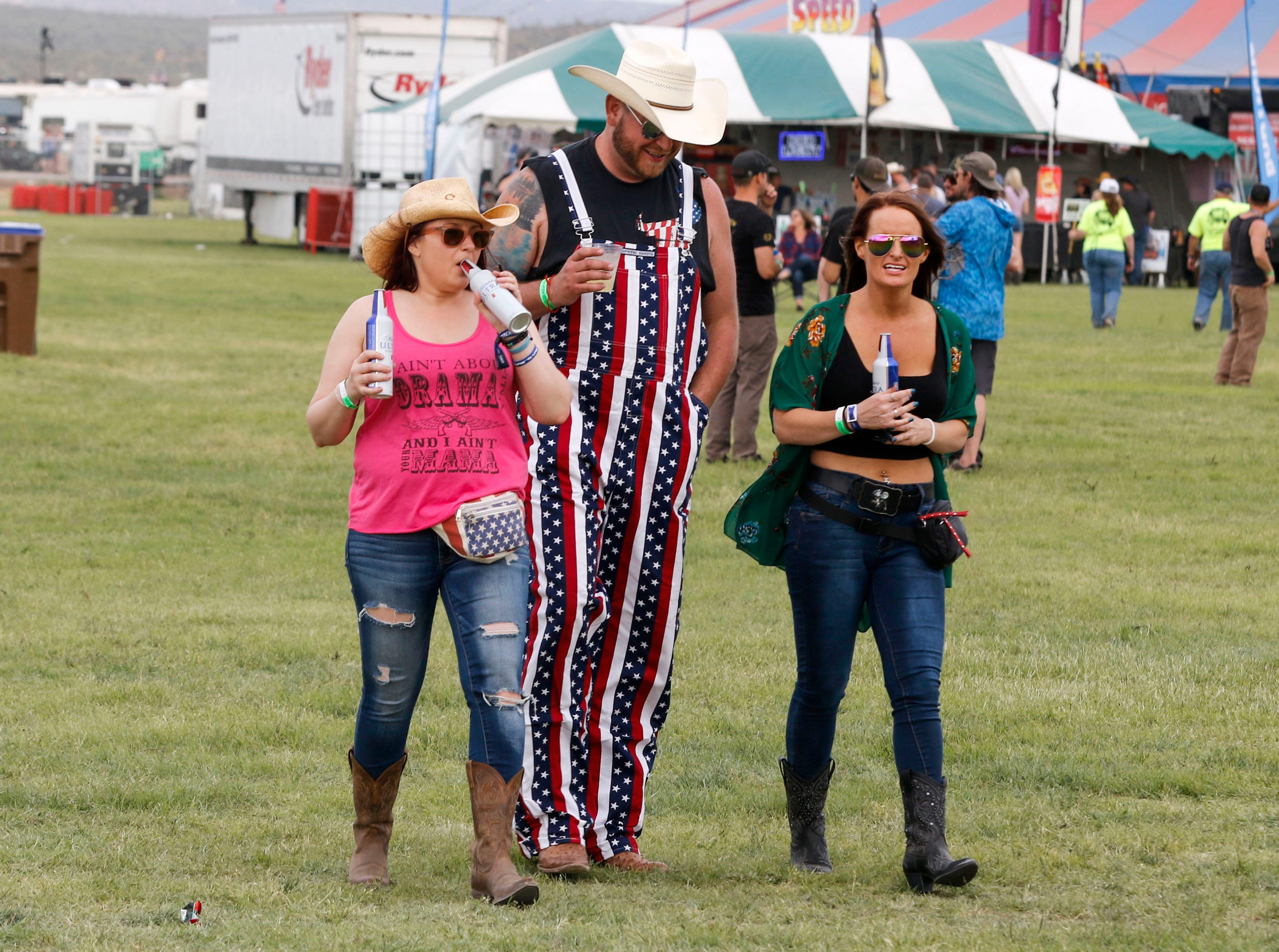 Music lovers make their way across the band area during Country Thunder Arizona on April 11, 2019, in Florence, Arizona.