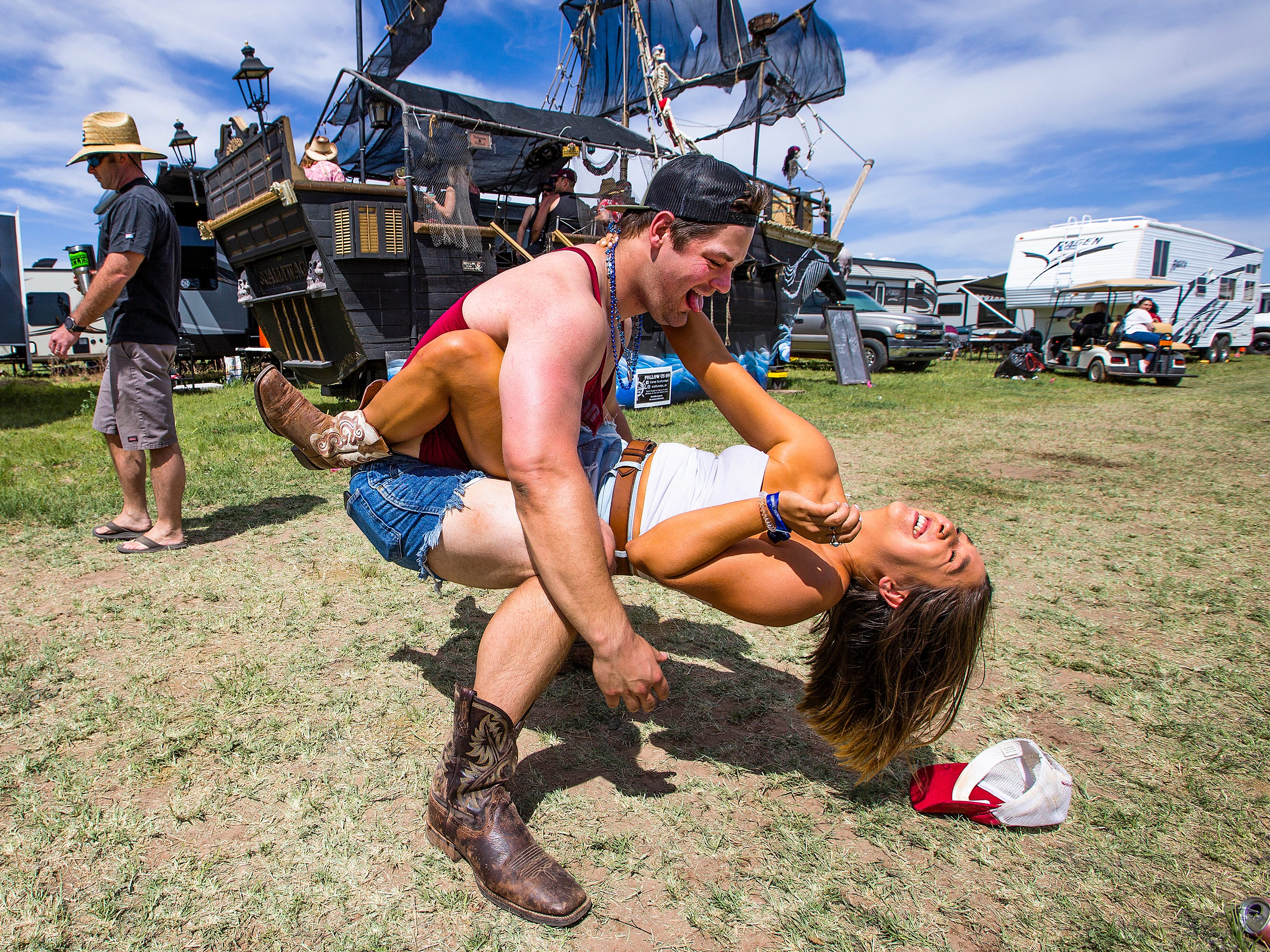 Eric Tomperi, 26, Flagstaff, and Samantha Weiss, 26, Chandler, dance at the Country Thunder Arizona 2019 music festival, Thursday , April 11, 2019.