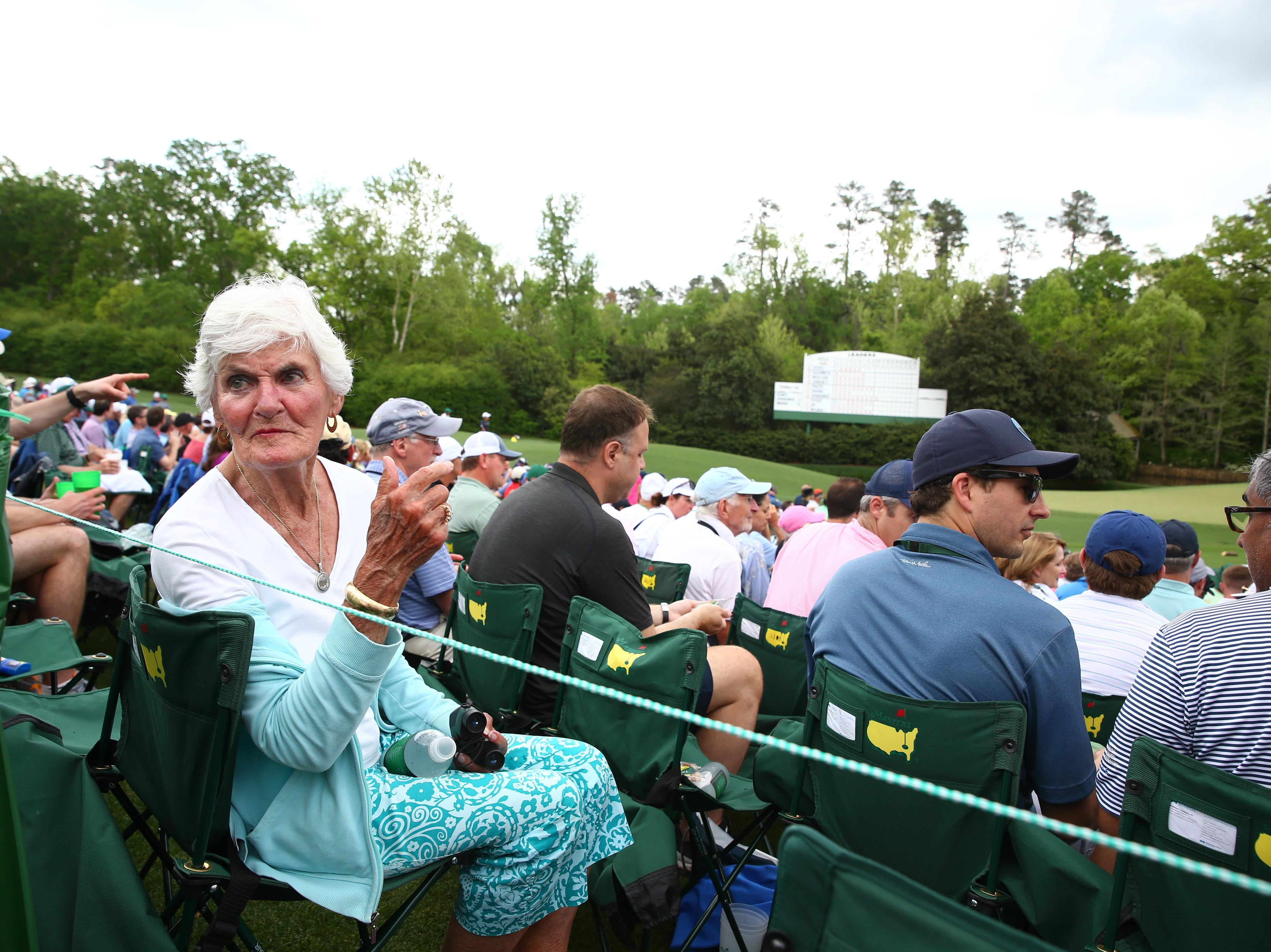 Apr 12, 2019; Augusta, GA, USA; Masters patron Joan Chittenden seated along the 12th hole during the second round of The Masters golf tournament at Augusta National Golf Club. Mandatory Credit: Rob Schumacher-USA TODAY Sports