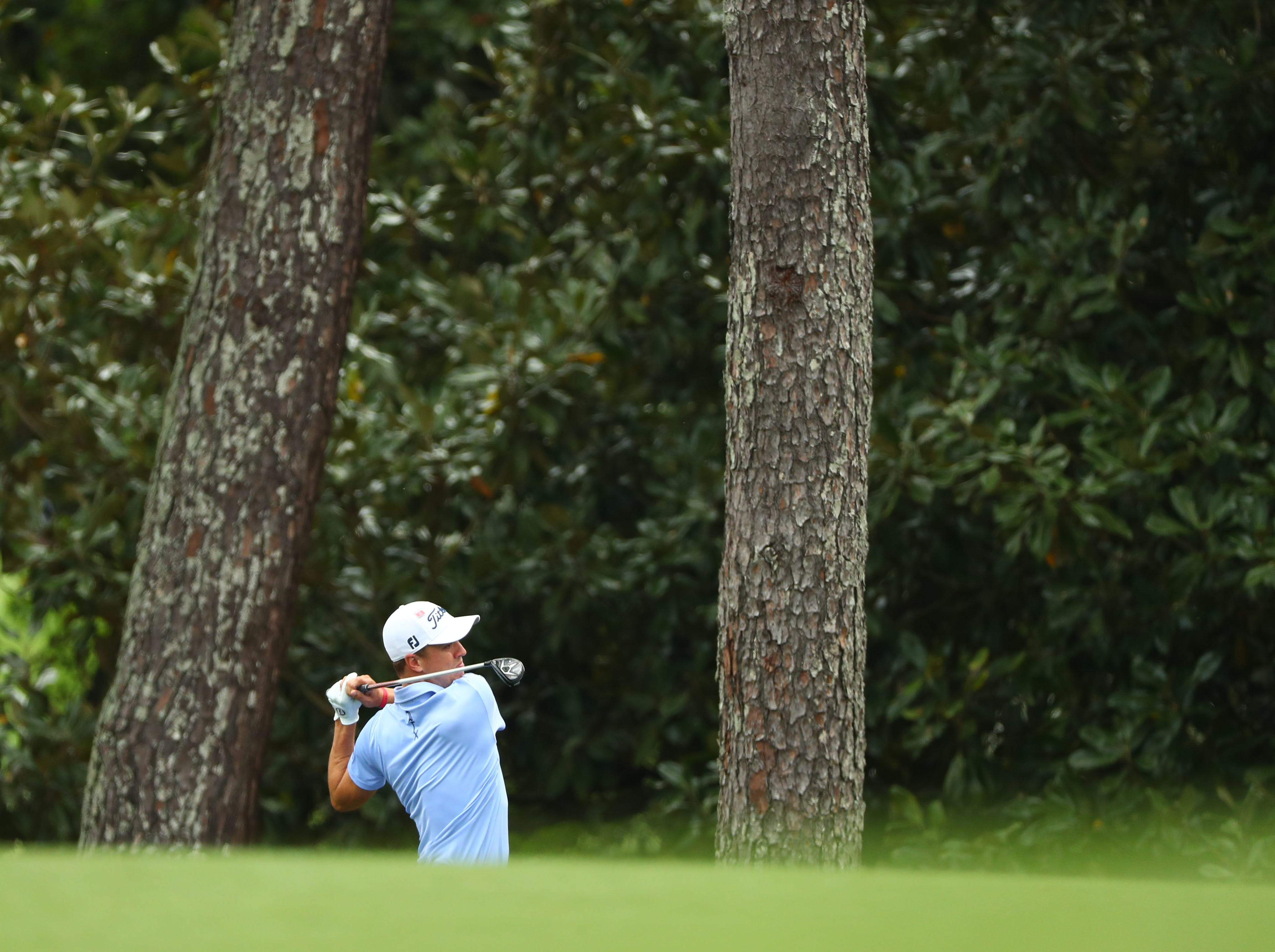 Apr 12, 2019; Augusta, GA, USA; Justin Thomas plays a shot on the 2nd hole during the second round of The Masters golf tournament at Augusta National Golf Club. Mandatory Credit: Rob Schumacher-USA TODAY Sports