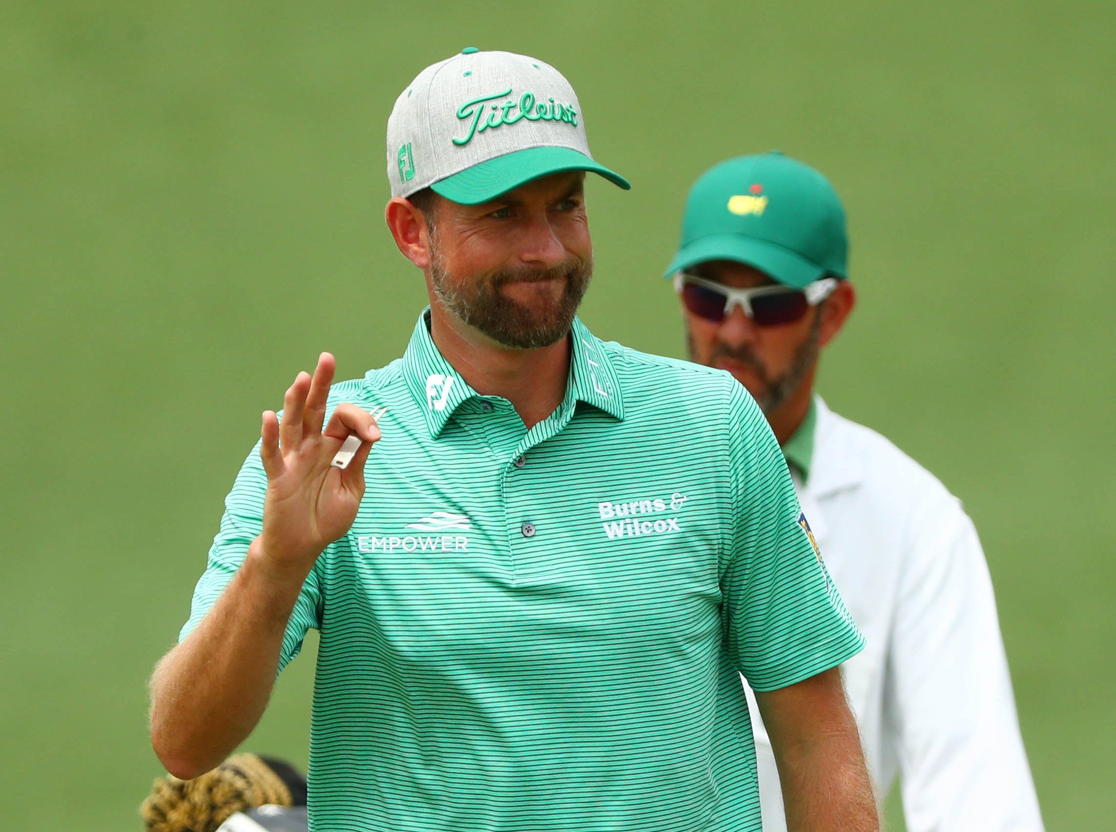 Apr 12, 2019; Augusta, GA, USA; Webb Simpson waves to the gallery on the 2nd green during the second round of The Masters golf tournament at Augusta National Golf Club. Mandatory Credit: Rob Schumacher-USA TODAY Sports