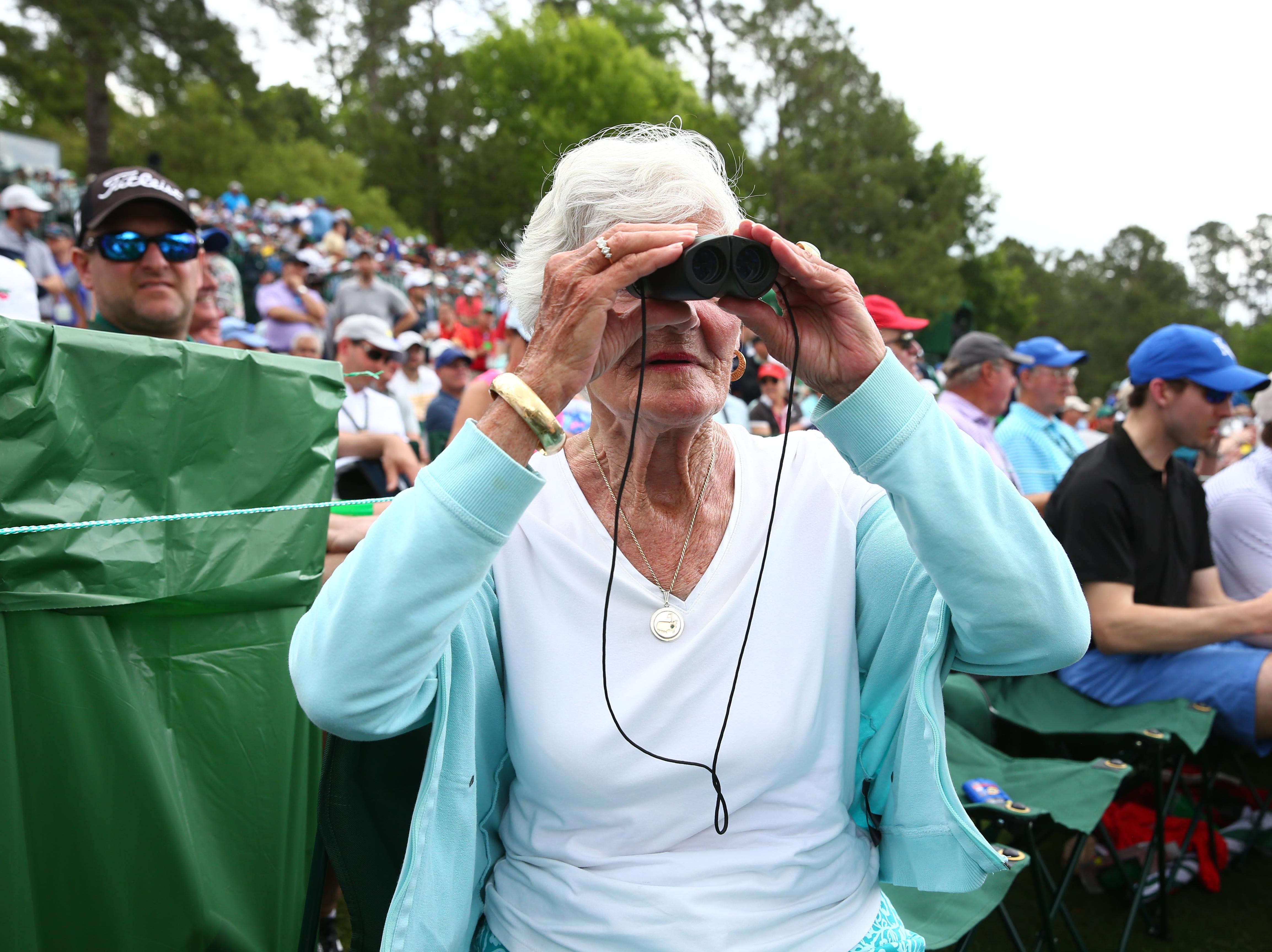 Apr 12, 2019; Augusta, GA, USA; Masters patron Joan Chittenden watches the action from along the 12th hole during the second round of The Masters golf tournament at Augusta National Golf Club. Mandatory Credit: Rob Schumacher-USA TODAY Sports