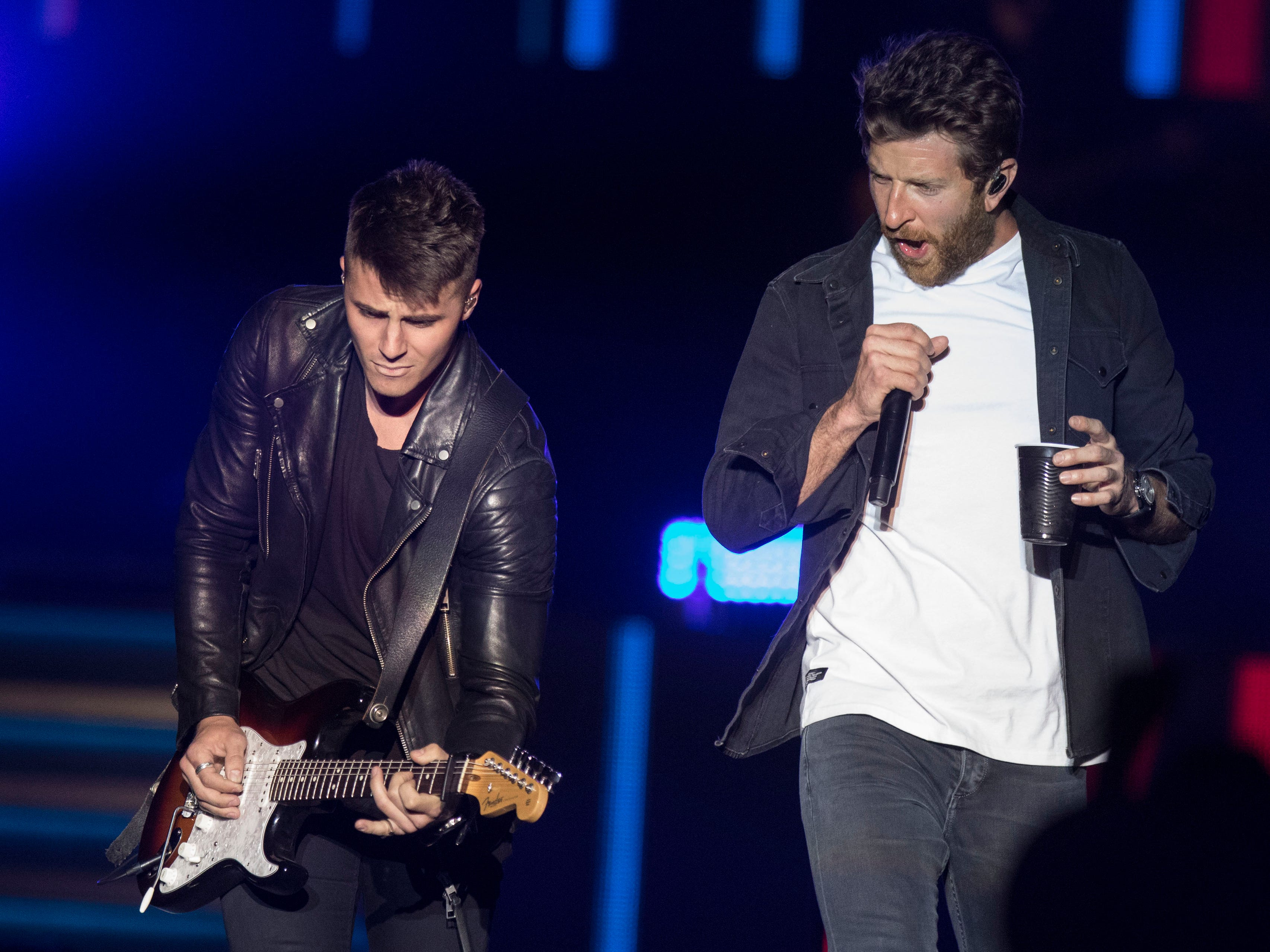 Brett Eldredge (right) and his guitarist entertain the crowd  during Country Thunder Arizona on April 11, 2019, in Florence, Ariz.