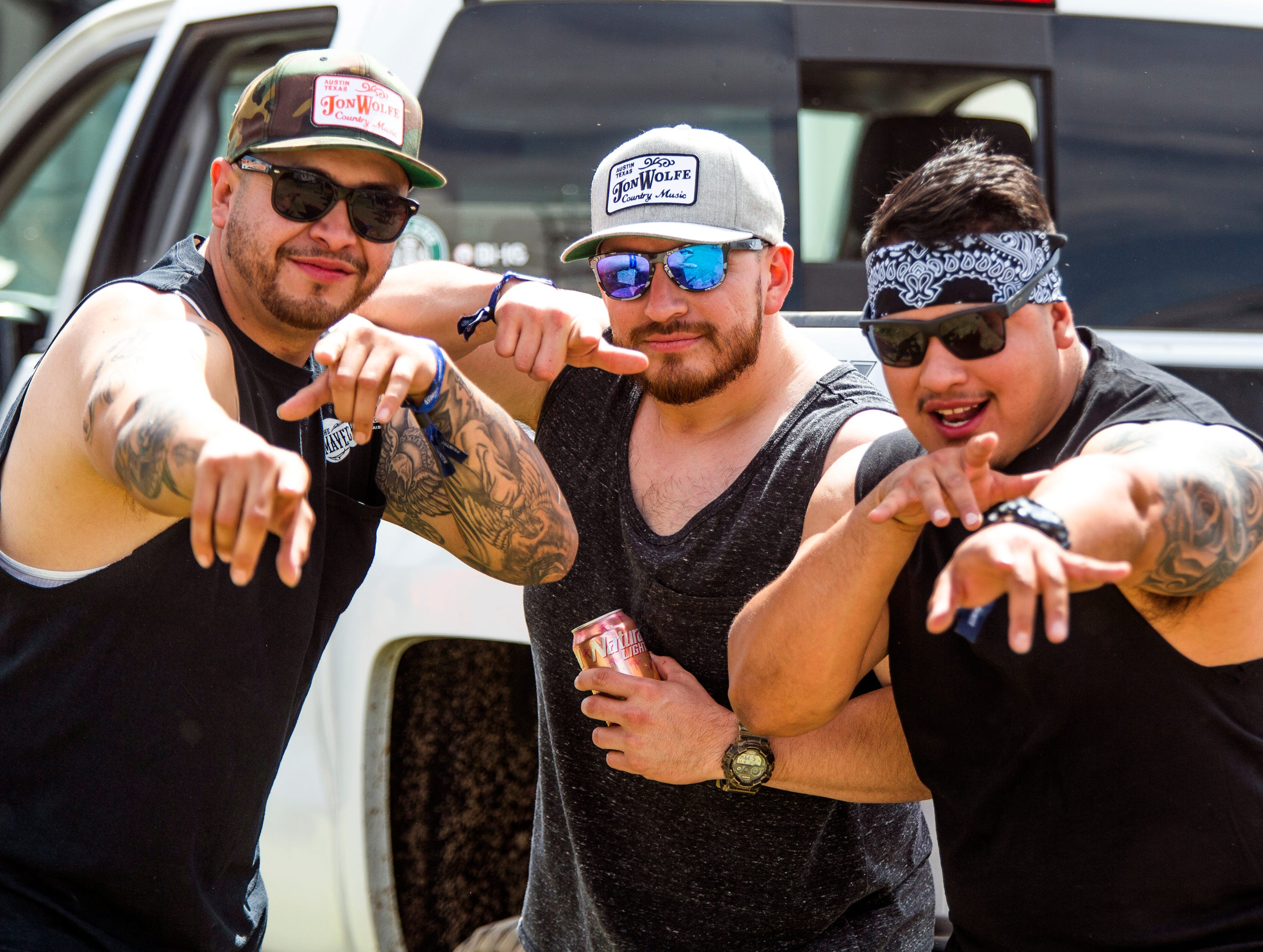 Half-brothers from Tucson enjoy themselves at Country Thunder Arizona 2019 near Florence, April 11, 2019. From left to right are; Rob Borquez, 28, Nathan Velador, 30, and Anthony Weeks, 28.