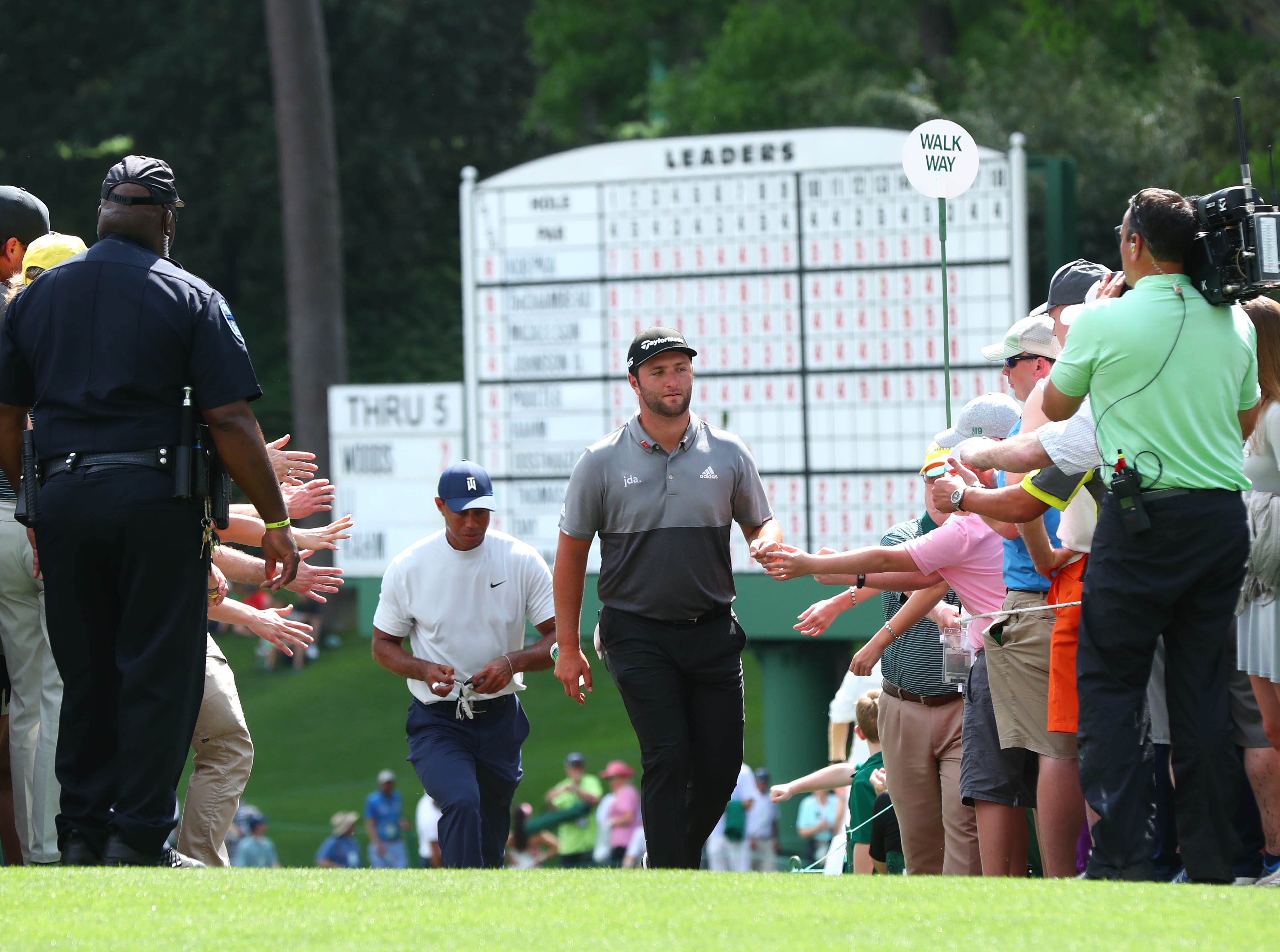 Apr 12, 2019; Augusta, GA, USA; Jon Rahm (right) and Tiger Woods walk to the 7th tee during the second round of The Masters golf tournament at Augusta National Golf Club. Mandatory Credit: Rob Schumacher-USA TODAY Sports