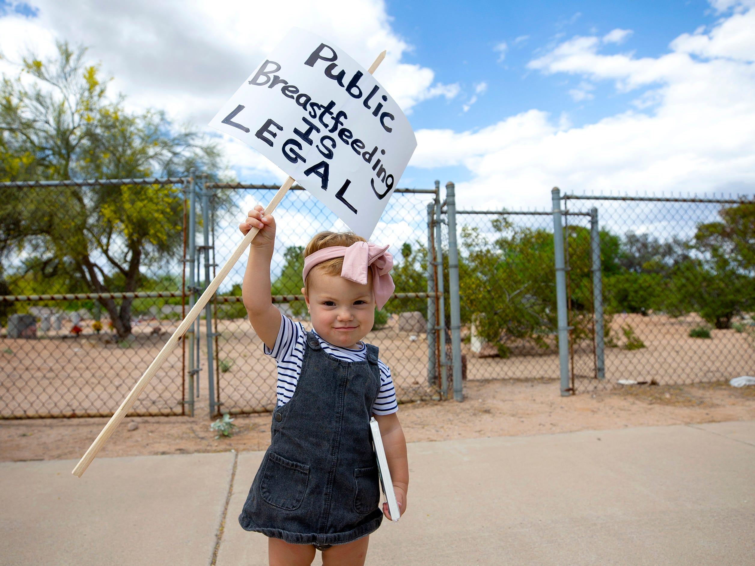 Monet Hoven, a 1 year old, holds a sign during a nurse-in at Kiva Elementary in Paradise Valley.