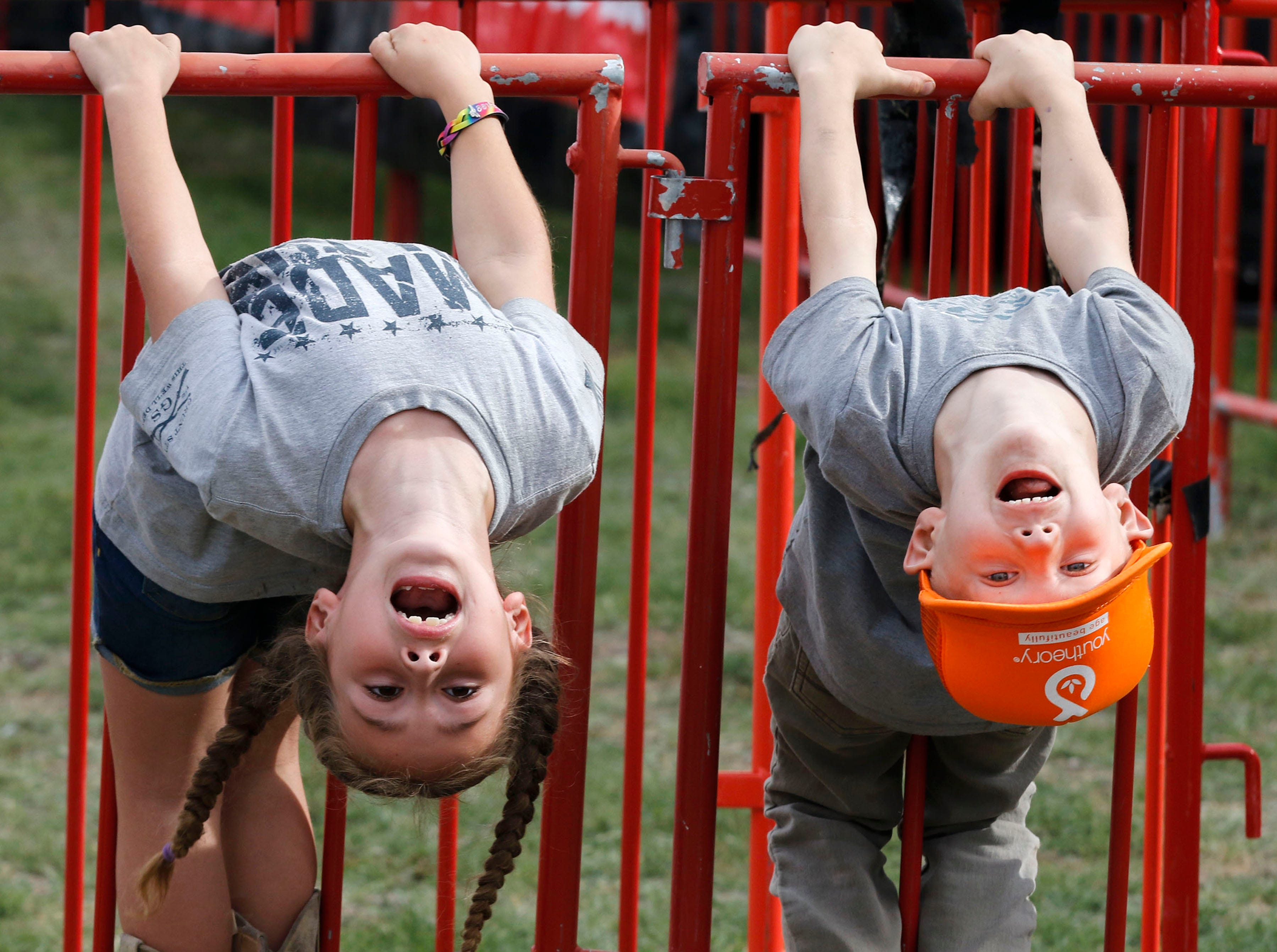 Haylee Fron 6, and her buddy Ethan Lee 6, both from Mesa hang from a barricade as The Cole Trains play during Country Thunder Arizona on April 11, 2019, in Florence, Arizona.