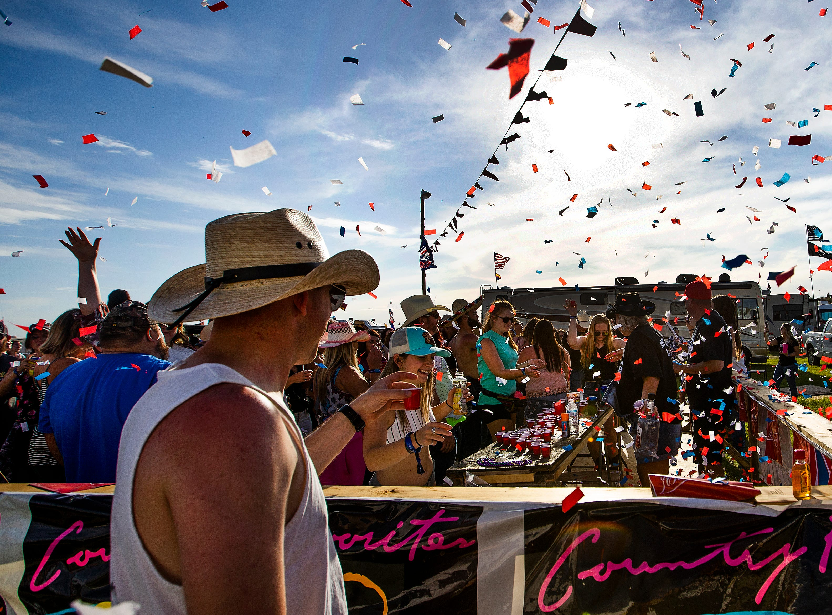 People make the first annual Country Thunder Arizona kickoff toast at Camp Burracho at the music festival, April 11, 2019.