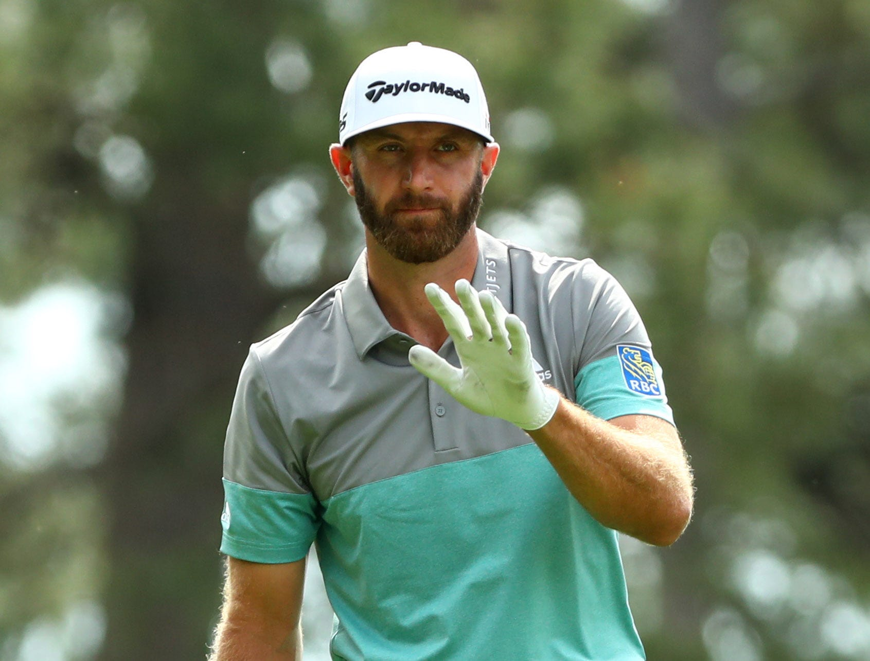 Apr 12, 2019; Augusta, GA, USA; Dustin Johnson reacts after hitting his tee shot on the 4th hole during the second round of The Masters golf tournament at Augusta National Golf Club. Mandatory Credit: Rob Schumacher-USA TODAY Sports
