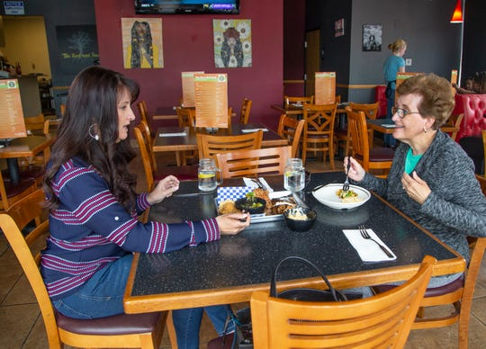 Amy Reagan and her mom, Diane Purvis, enjoy lunch at the Root and Soul restaurant in Scottsdale.